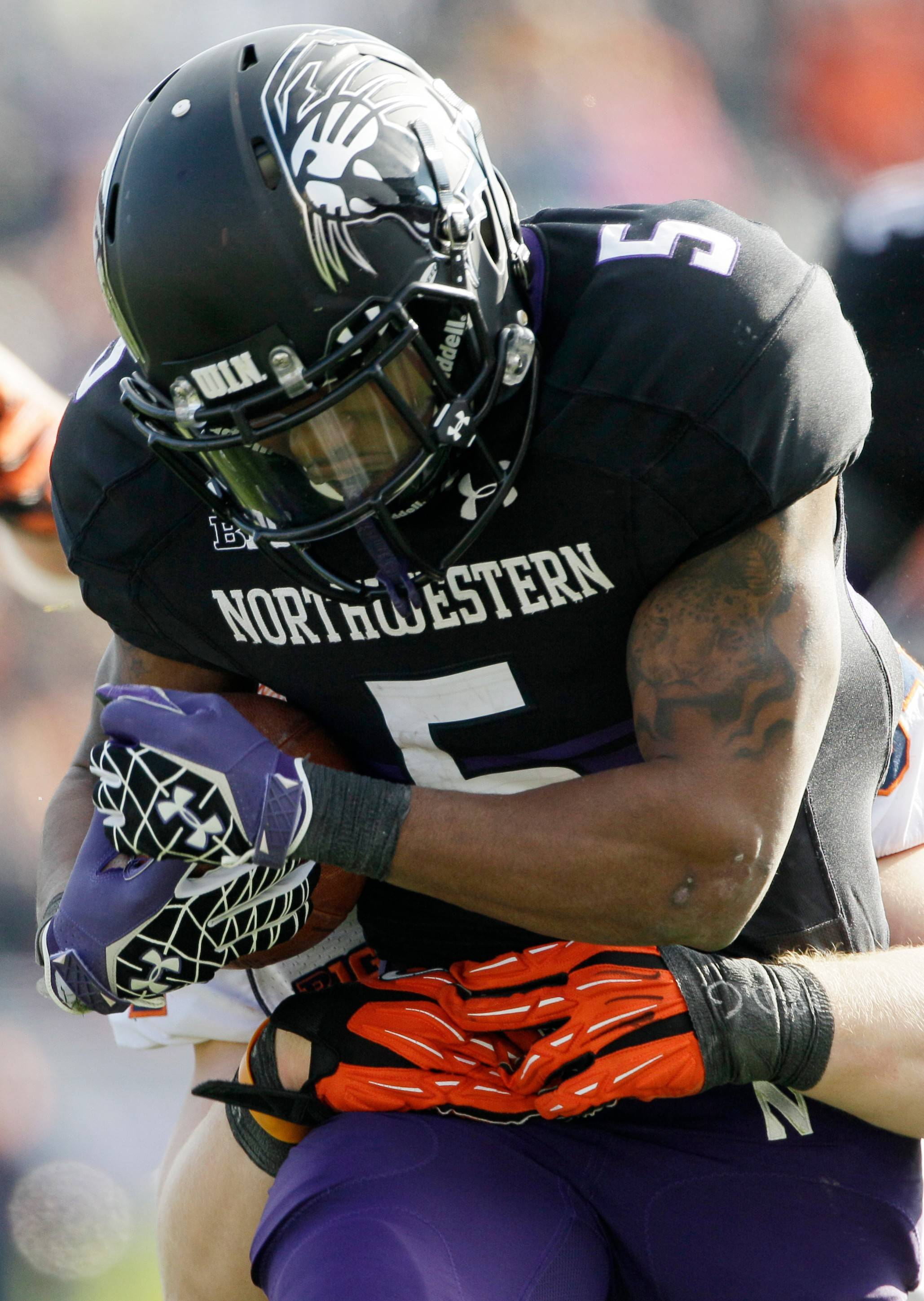 Northwestern running back Venric Mark (5) was suspended by school officials Friday and will miss the first two games of the season for coach Pat Fitzgerald's team.