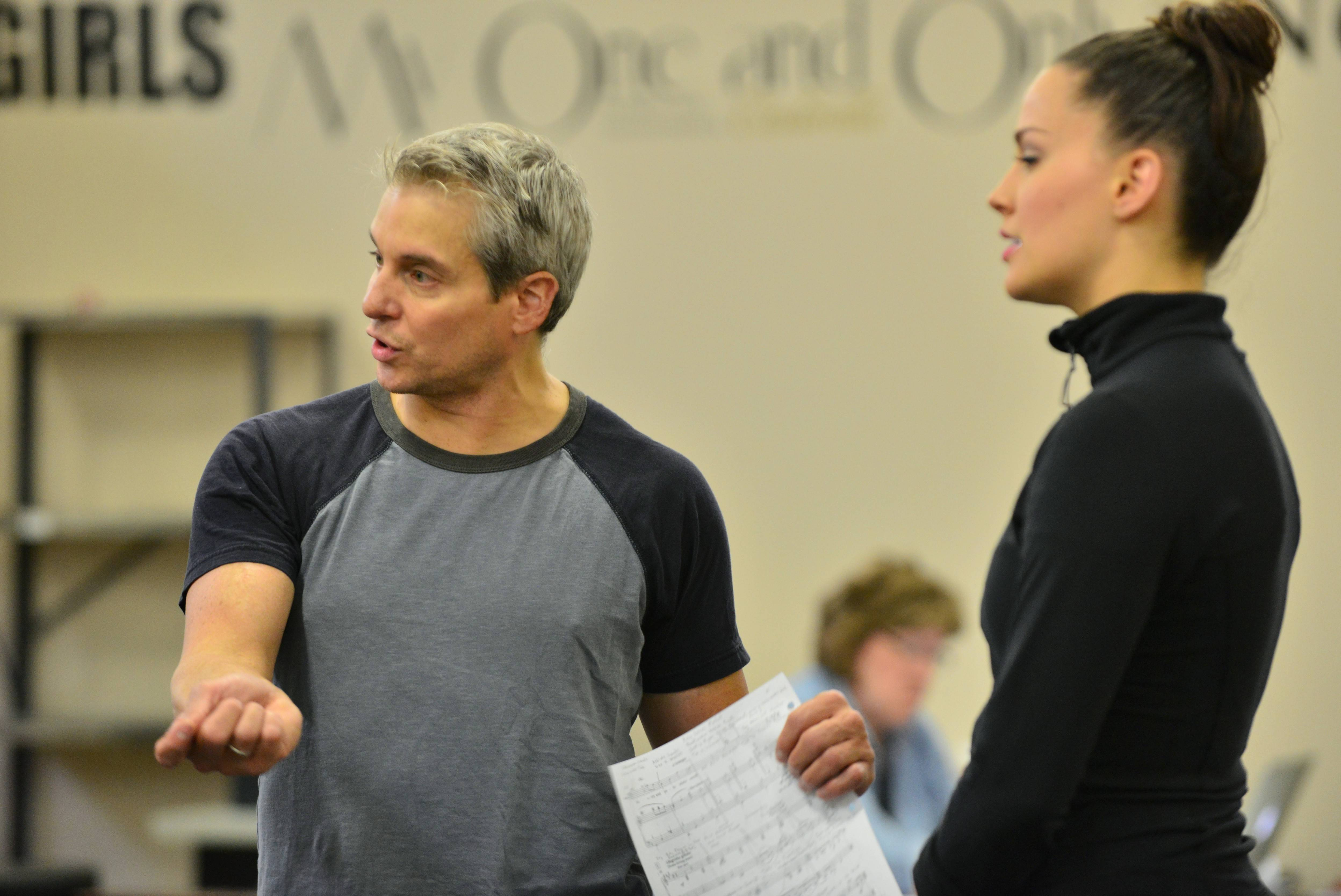 "Choreographer Alex Sanchez works with Alison Jantzie, starring as the former ""Miss Turnstiles"" Ivy, during rehearsals for the Marriott Theatre's 70th anniversary production of Leonard Bernstein's 1944 Broadway musical ""On the Town."""