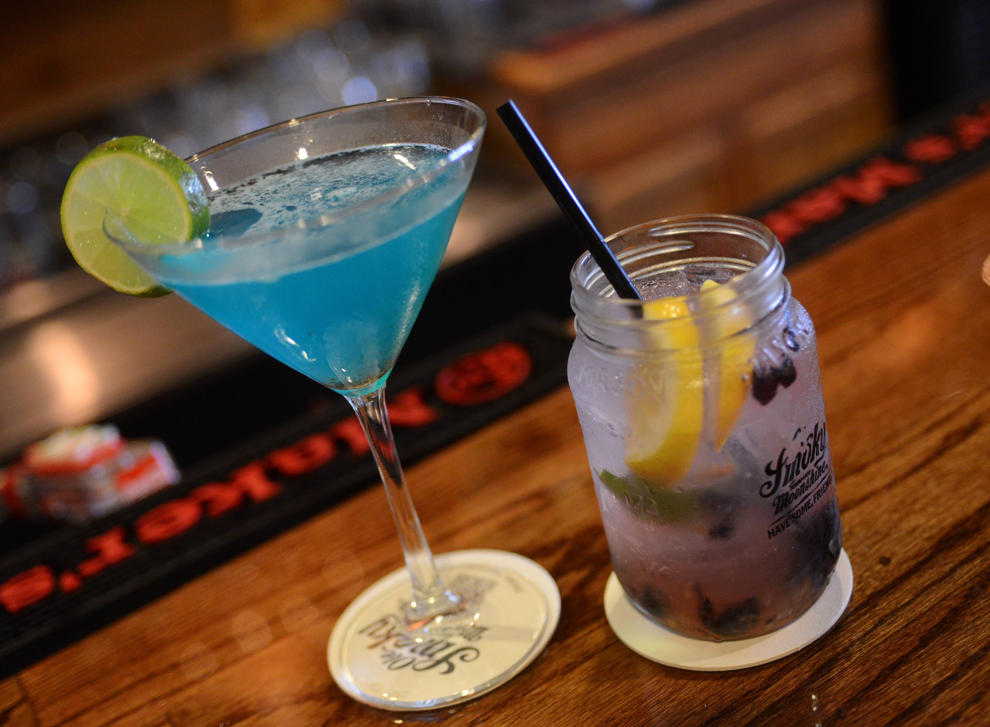 The Blue Lagoon, left, and Bees Knees are among the cocktails at The Still Bar and Grill in Bartlett.