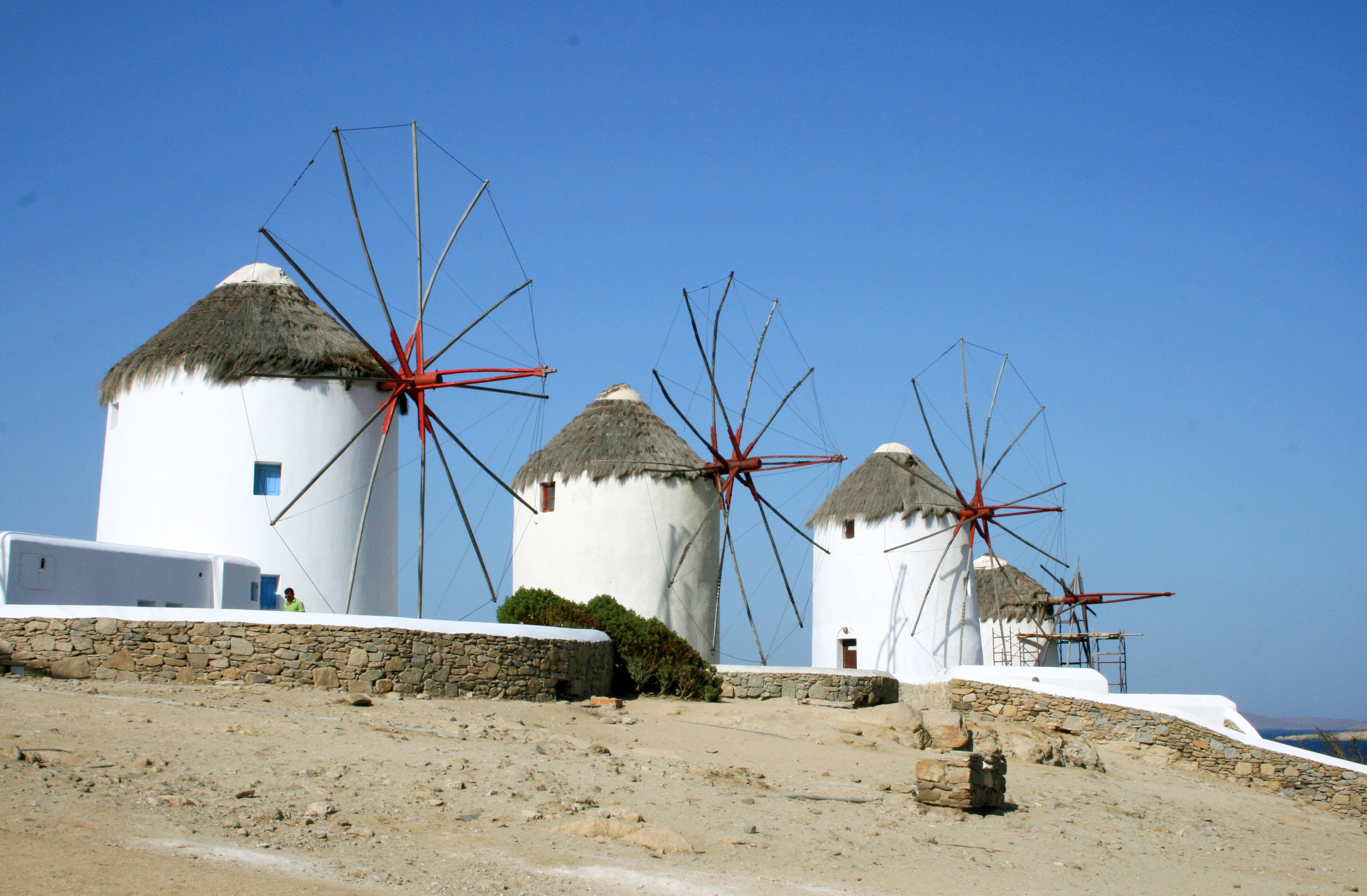Picturesque windmills dot the landscape on the island of Mykonos in the Cyclades. The tradition of building windmills on the island dates back centuries.