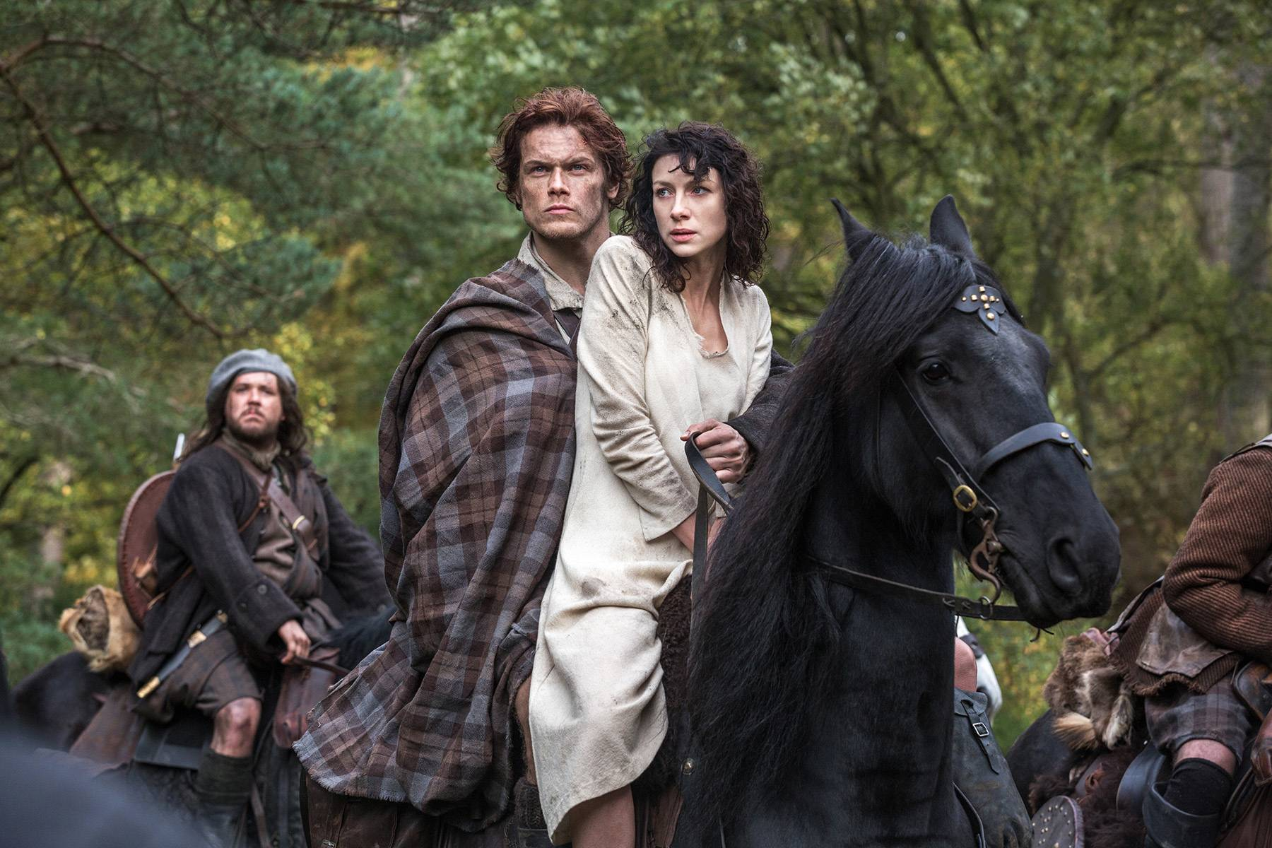 "Claire Randall (Caitriona Balfe), left, Jamie Fraser (Sam Heughan) and Rupert MacKenzie (Grant O'Rourke) are the main players in Starz's new TV series ""Outlander,"" premiering Saturday."
