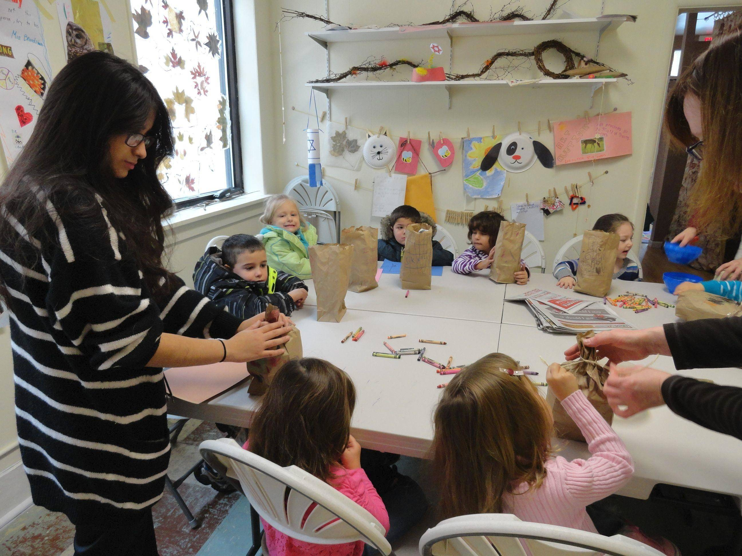 Fox Valley Jewish School students in prekindergarten to second grade made treat bags for the squirrels at Fox Valley Wildlife Center in Elburn.