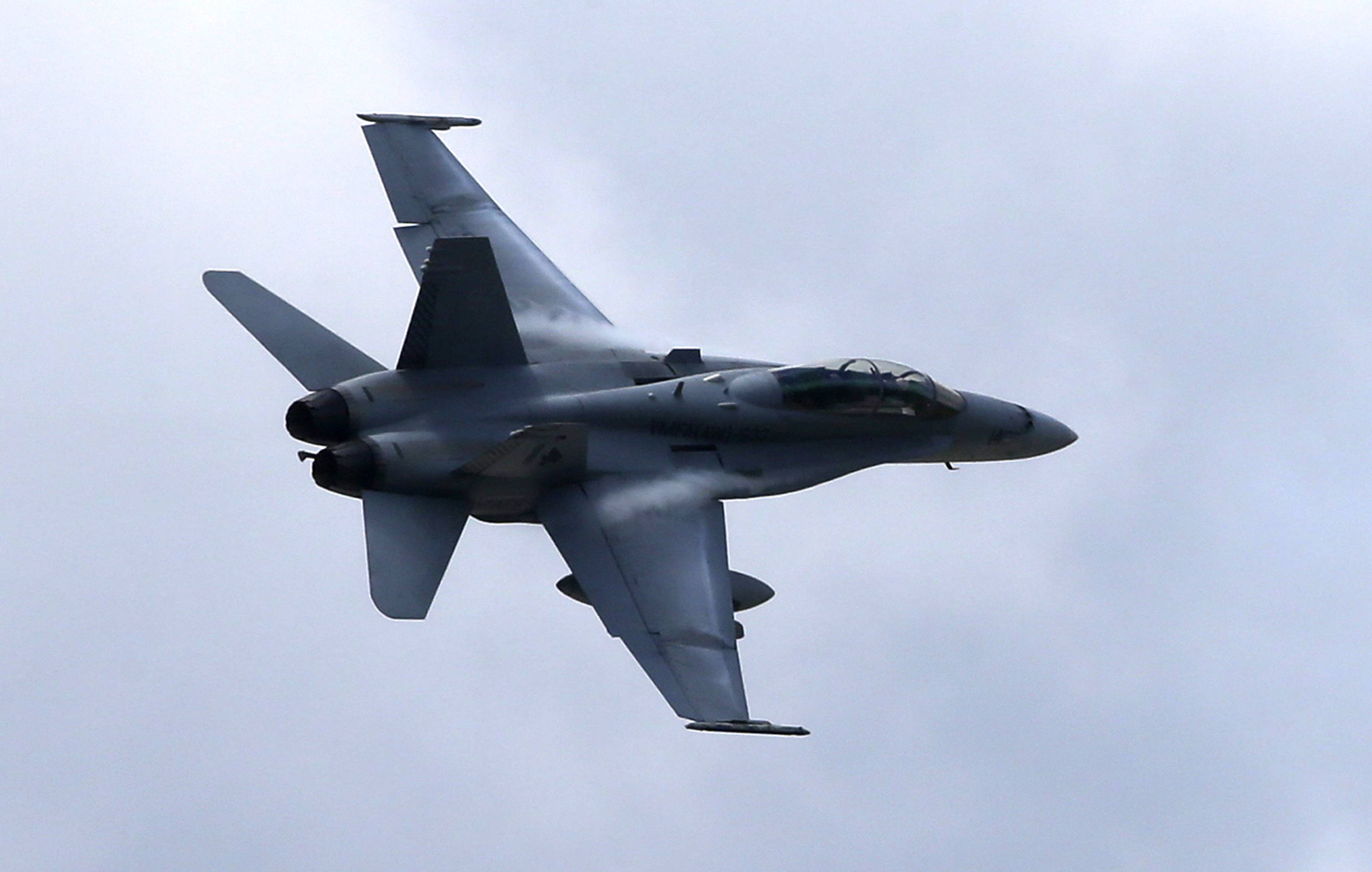 A U.S. Marine F/A-18 Hornet jet. The U.S. launched its first airstrikes into Iraq Friday. Rear Adm. John Kirby, Pentagon spokesman, said two F/A-18 fighters flying off the aircraft carrier USS George HW Bush in the Persian Gulf dropped two laser-guided 500-pound bombs on an Islamic State artillery piece and the truck towing it.
