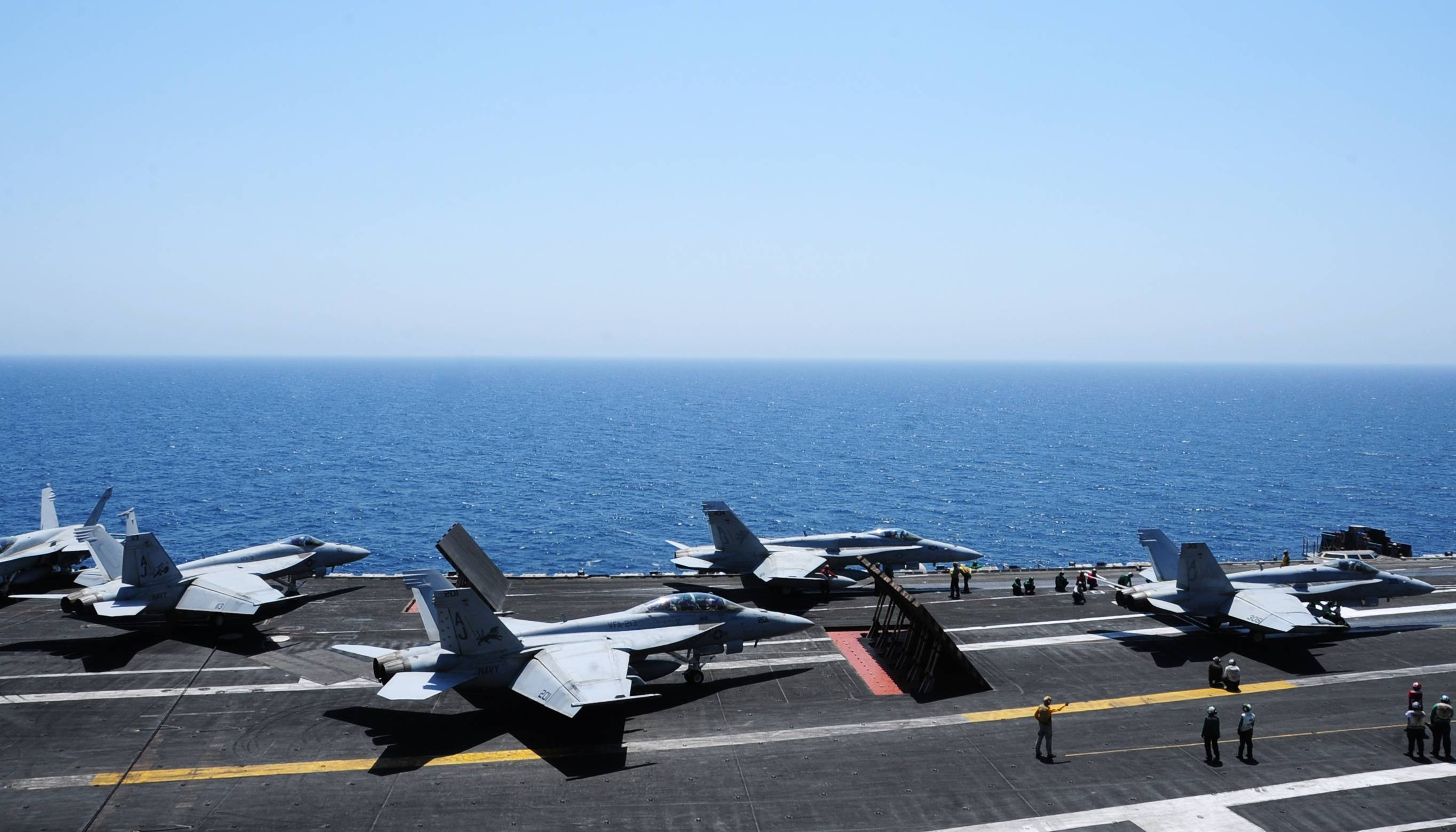 Sailors launch aircraft from the aircraft carrier USS George H.W. Bush on Thursdayin the Persian Gulf.
