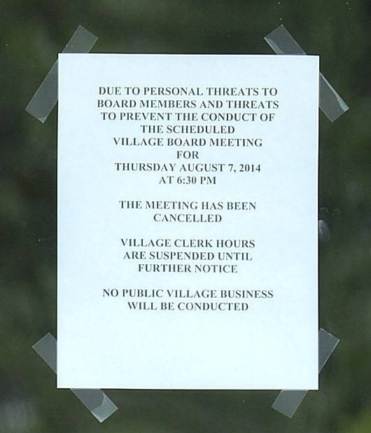 Oakwood Hills village hall remains closed due to threats made against village board members, which also forced the cancellation of Thursday night's village board meeting.