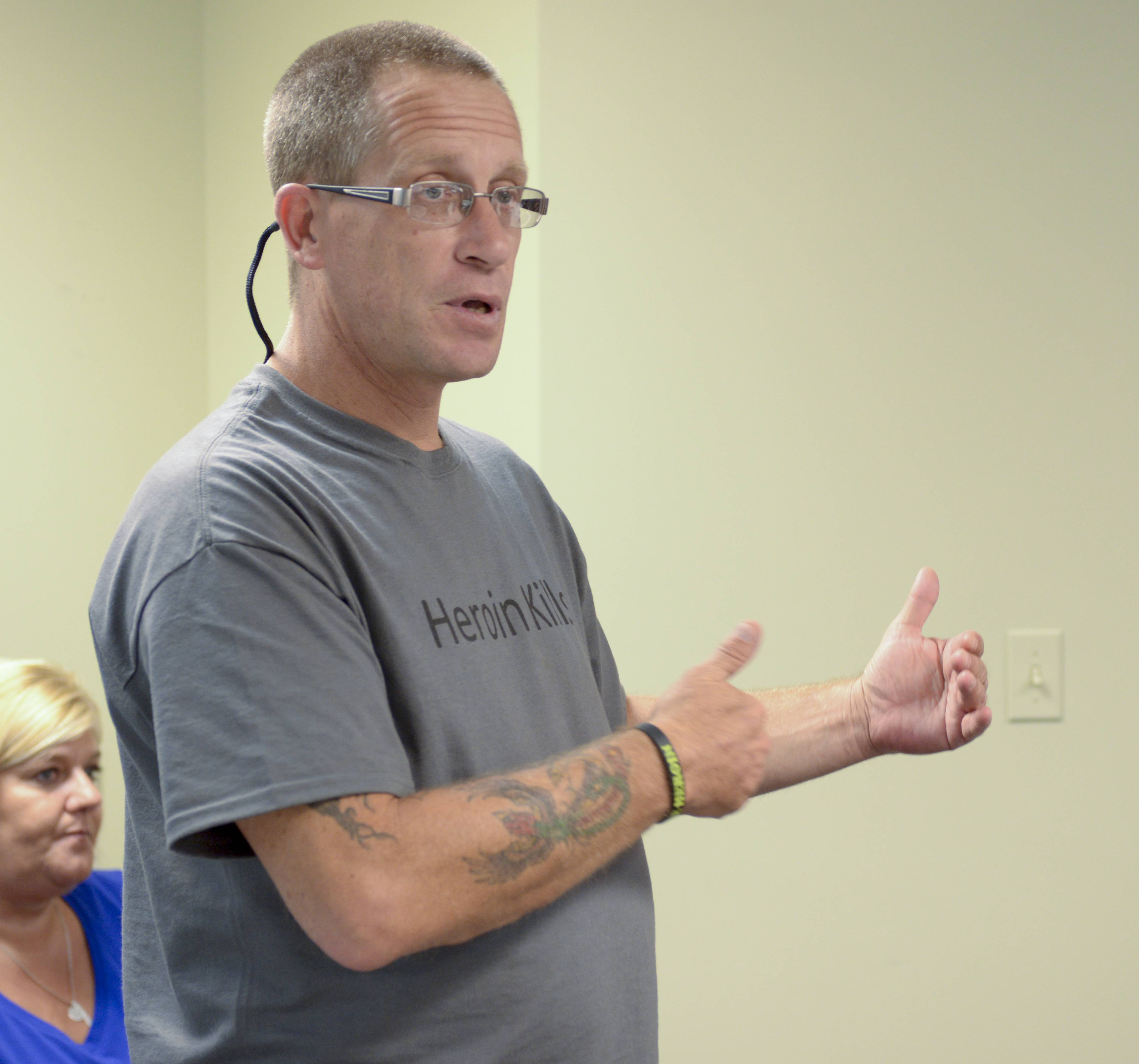 Tim Ryan of Naperville speaks Thursday night about the loss of his son, Nick, to an apparent heroin overdose and the importance of having the overdose reversal drug Naloxone available. Ryan, who himself is a recovering heroin addict, hosted the training session less than a week after his son's death Aug. 1.