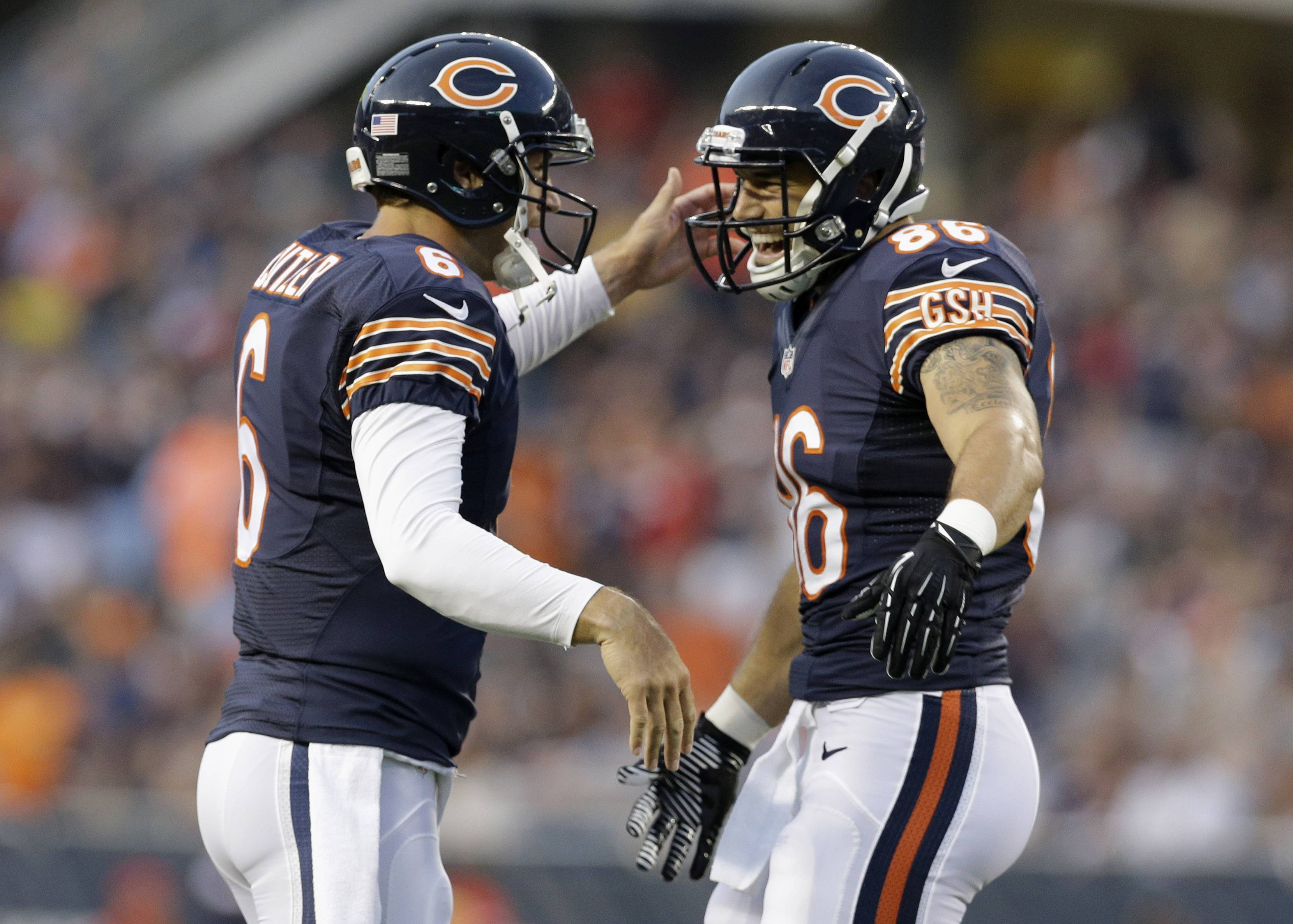 Chicago Bears quarterback Jay Cutler (6) celebrates a touchdown with tight end Zach Miller (86) in the first half of an NFL preseason football game against the Philadelphia Eagles on Friday, Aug. 8, 2014, in Chicago.
