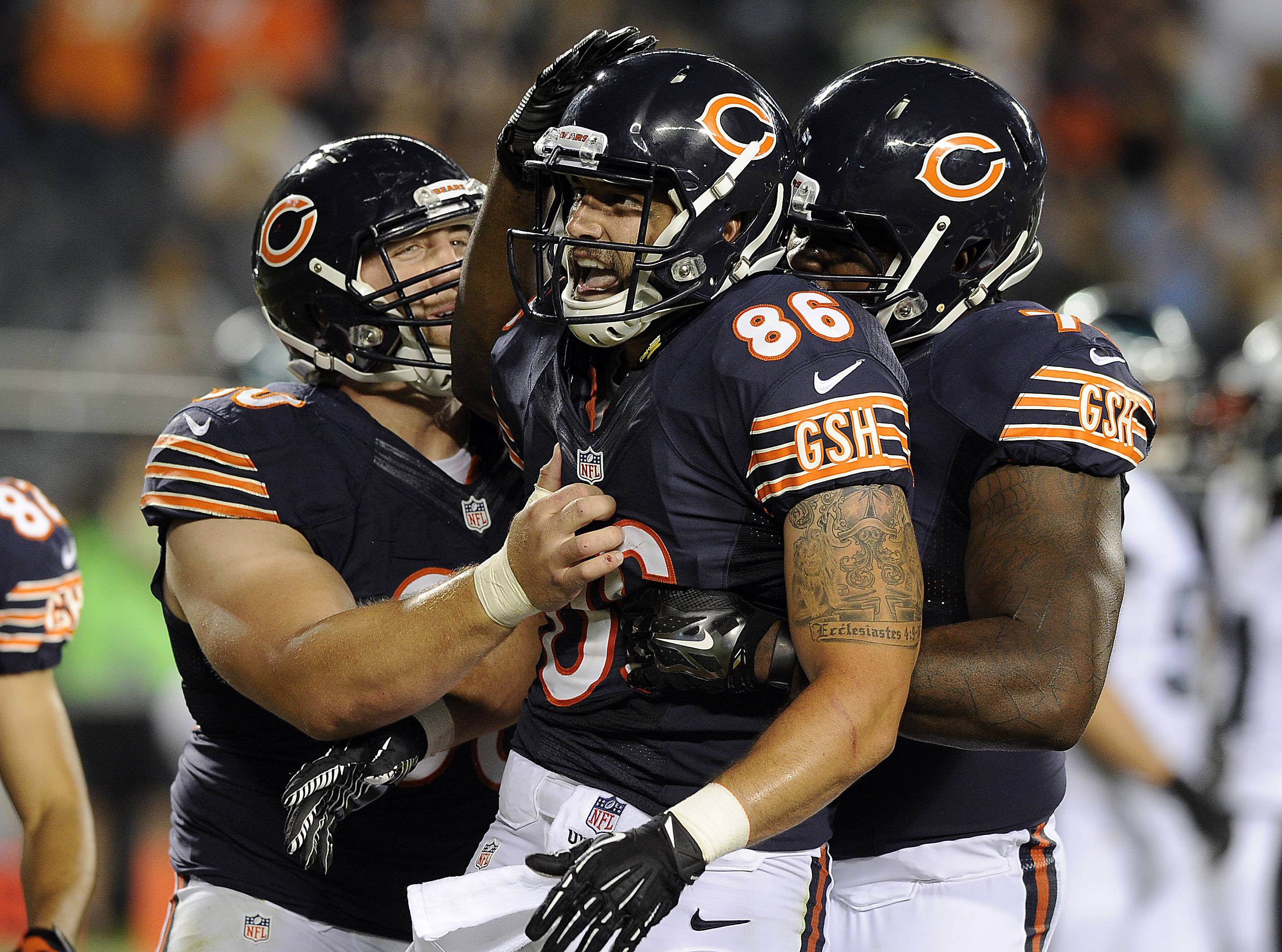 Mark Welsh/mwelsh@dailyherald.comChicago Bears Zach Miller hauls in Jordan Palmer's touchdown pass in the second quarter tying-up the game 14-all against Philadelphia at Soldier Field in Chicago. Here he celebrates with his teammates.
