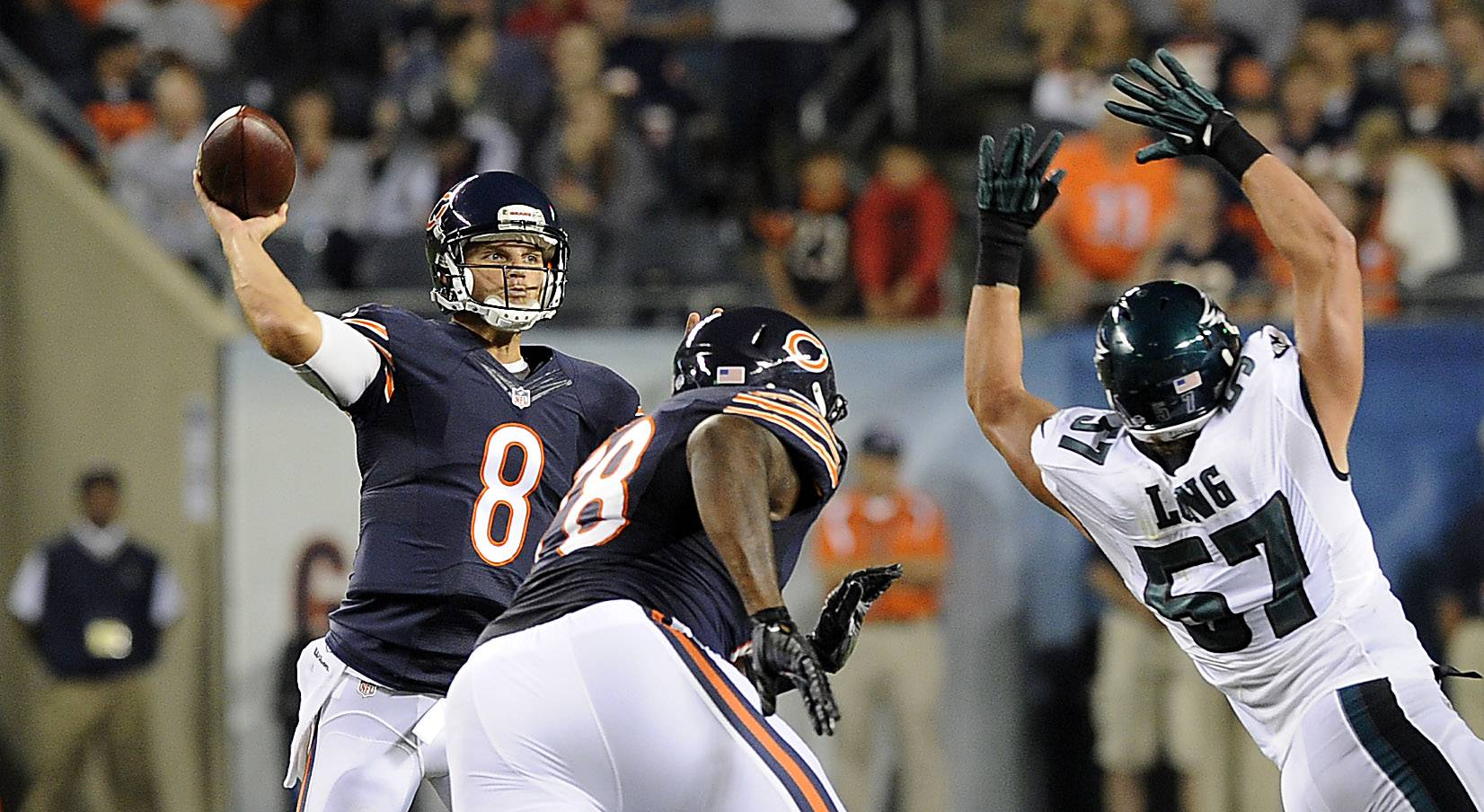 Chicago Bears quarterback Jimmy Clausen starts the third quarter with a pass as Philadelphia's Travis Long tries to block the pass.