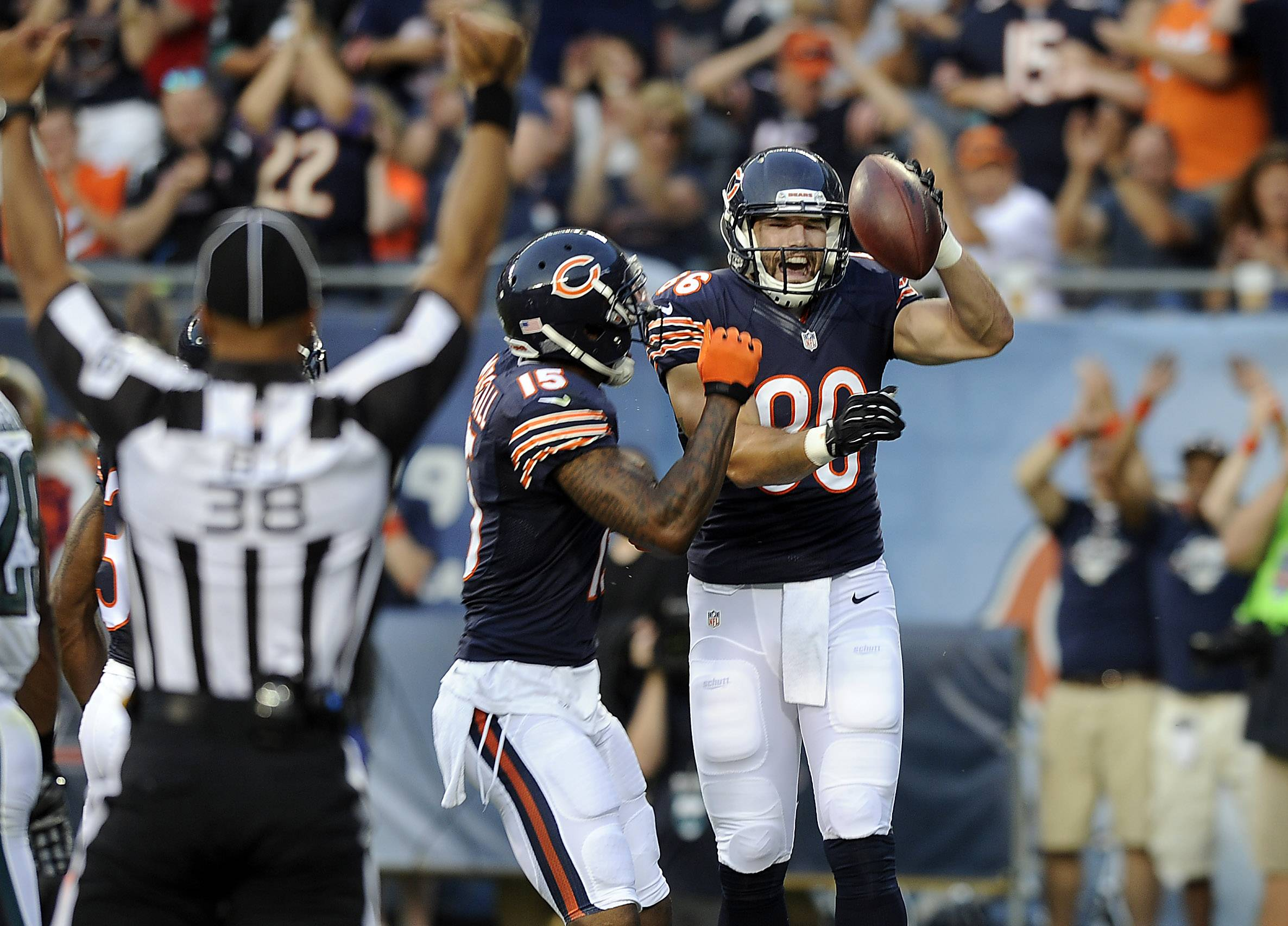 Chicago Bears Zach Miller celebrates his first quarter touchdown with teammate Brandon Marshall.