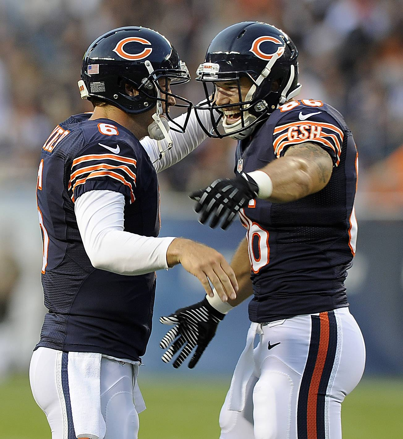Chicago Bears Jay Cutler comes together with Zach Miller after his touchdown from Cutler's pass.