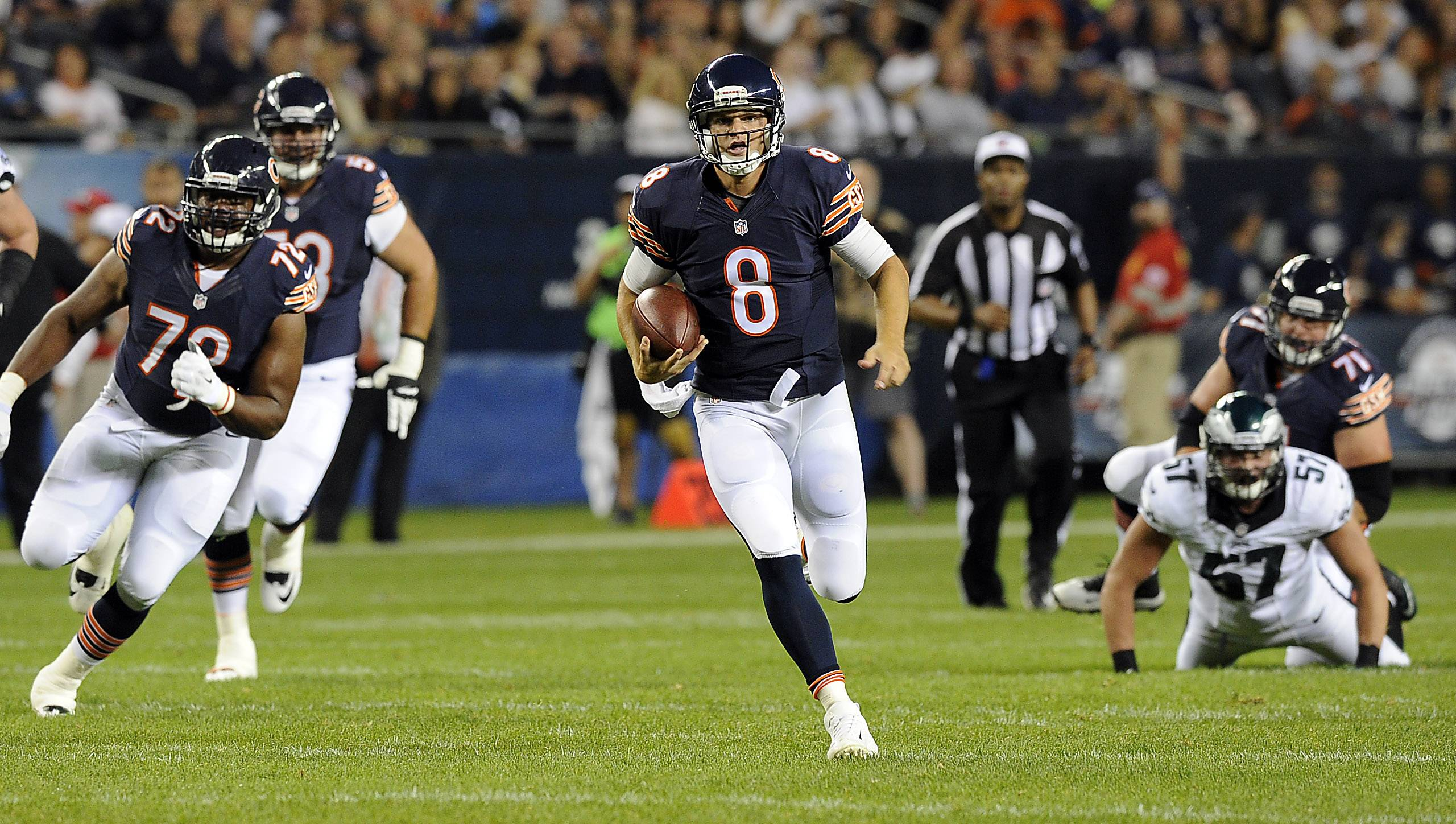Chicago Bears quarterback Jimmy Clausen scrambles for yardage in the third quarter. This set up a pass play for a touchdown.