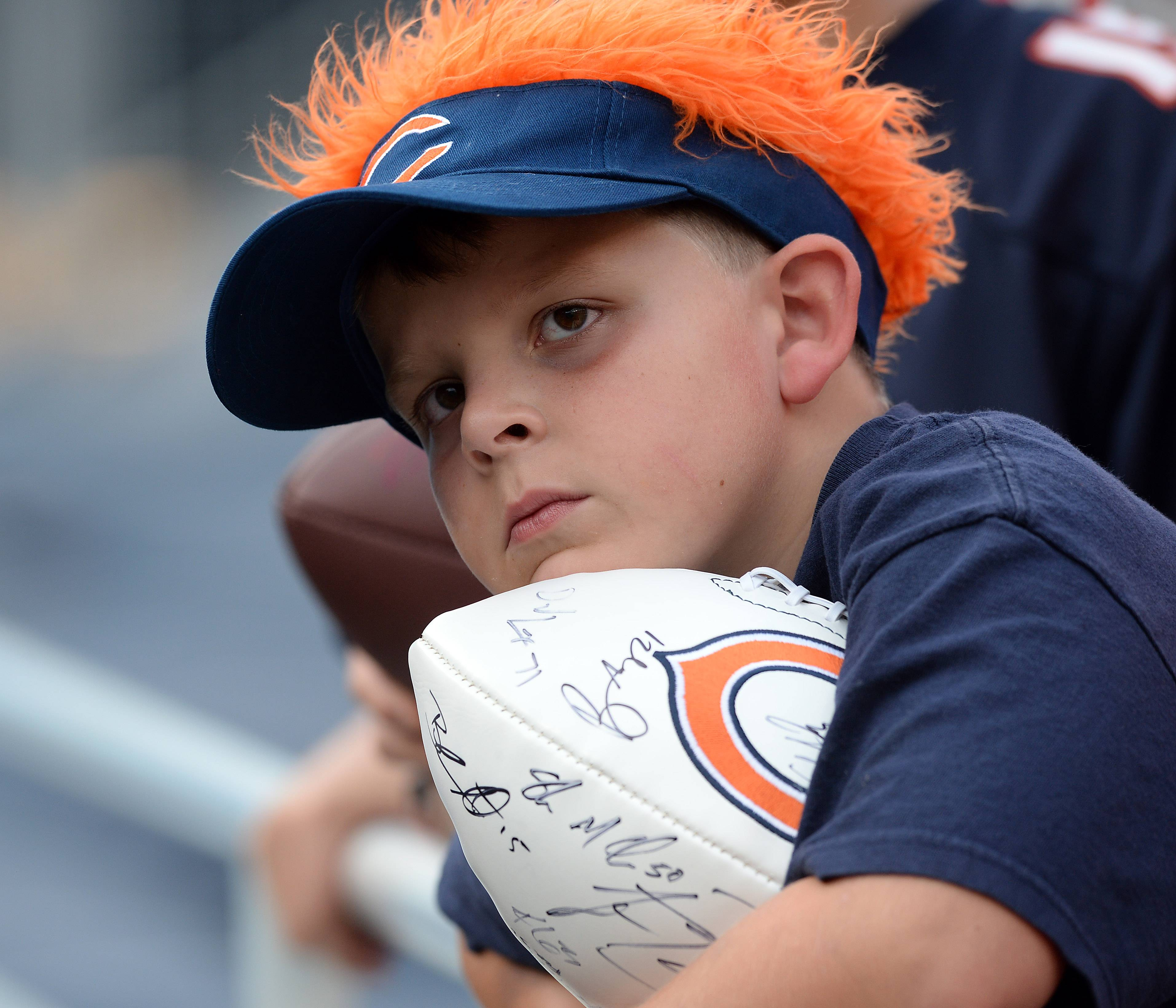 Jacob Newcomb, 7, of Gurnee looks for his favorite Bears players for autographs.