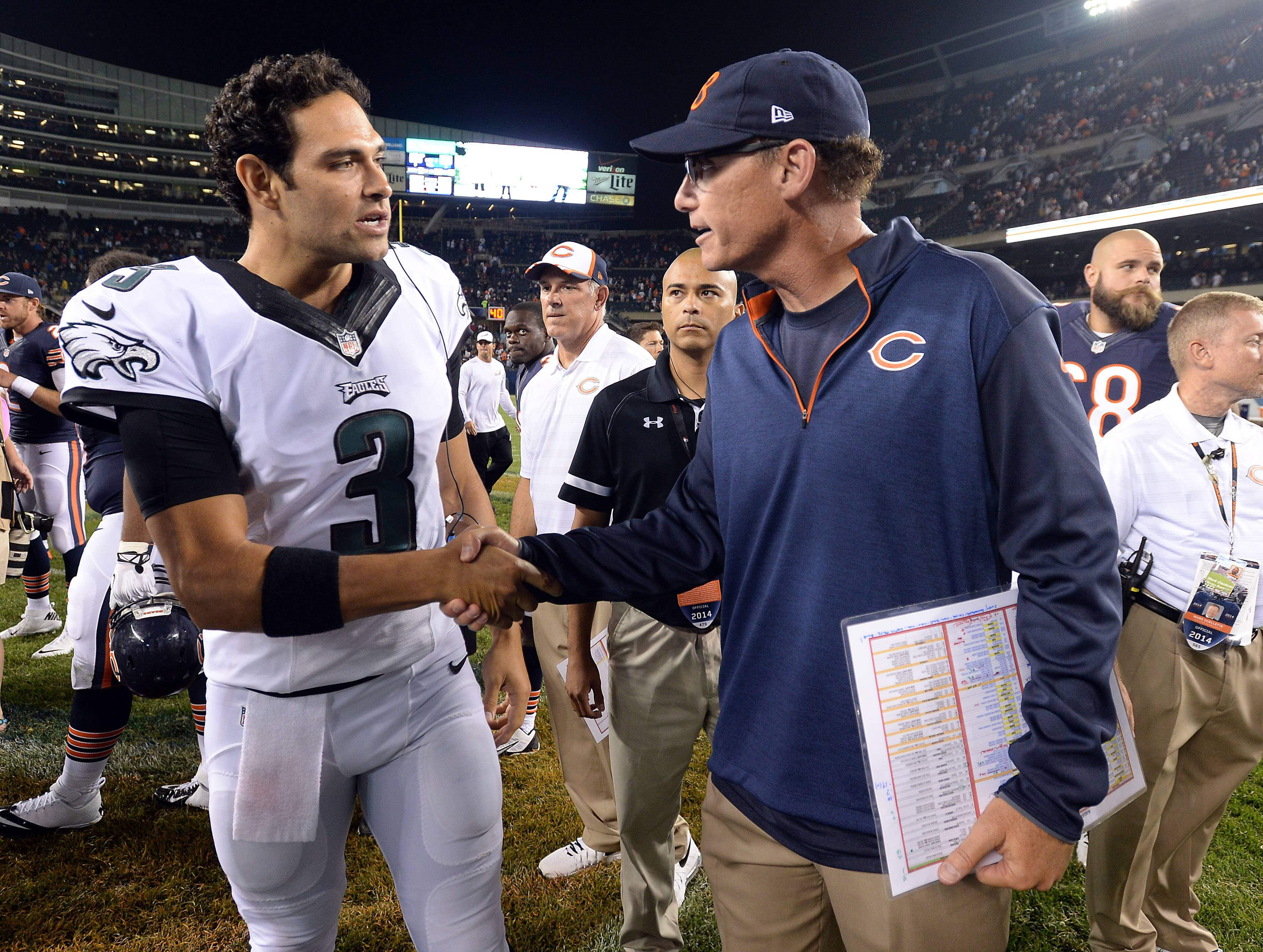 Bears coach Marc Trestman and Philadelphia's quarterback Mark Sanchez come together at the end of the game.