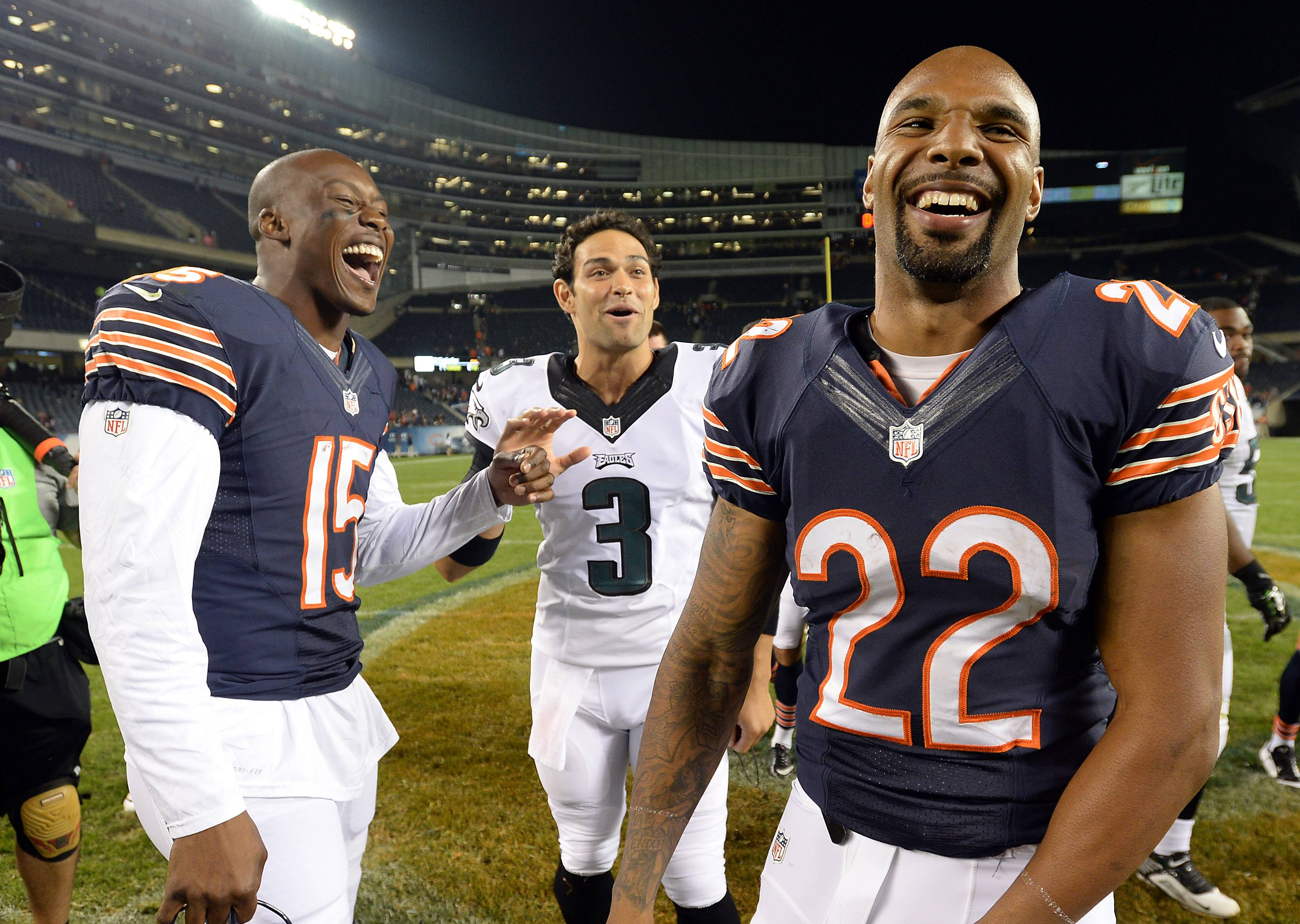 Bears Matt Forte, Brandon Marshall and Philadelphia's Mark Sanchez come together after the game.