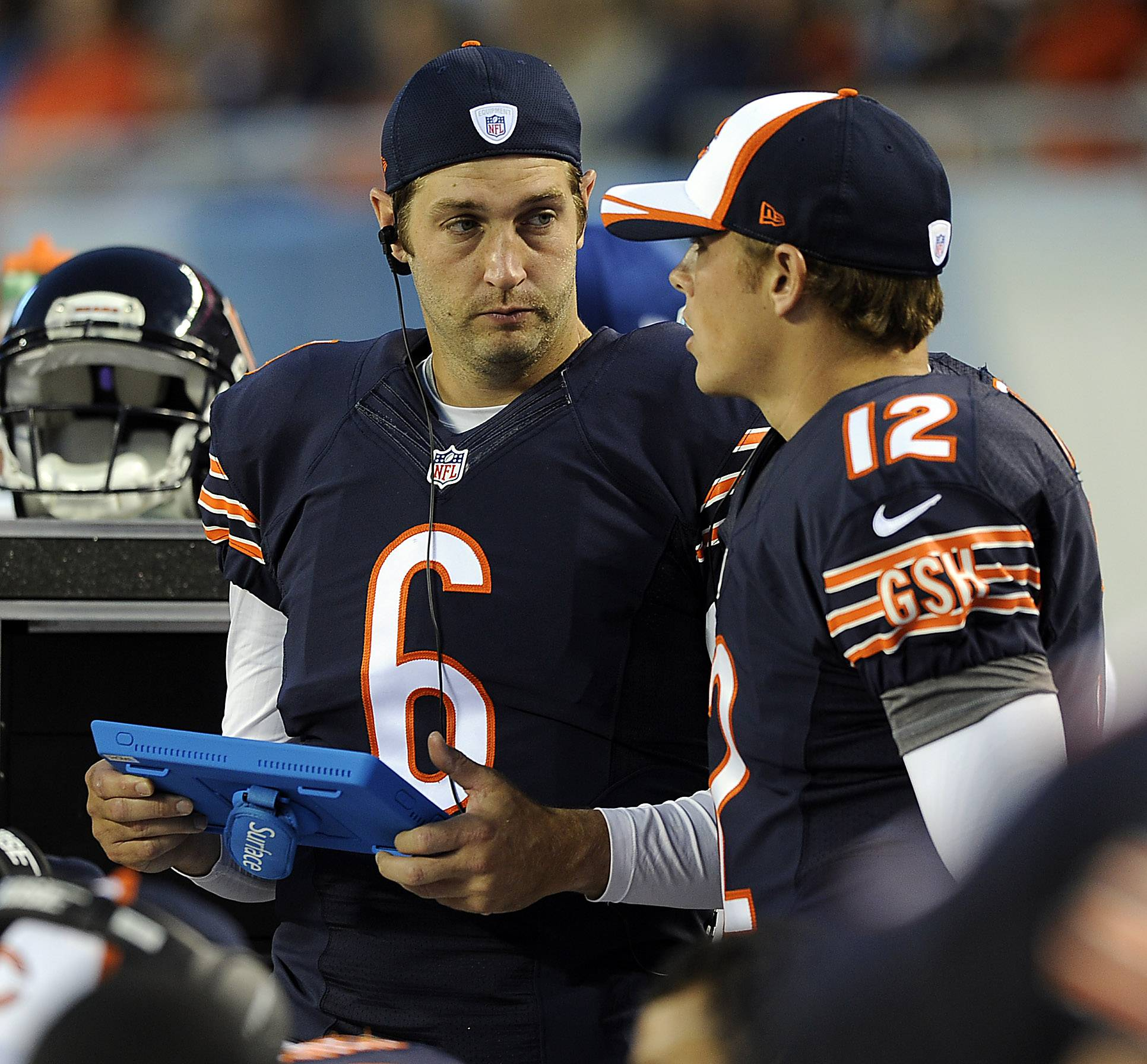 Chicago Bears Jay Cutler talks with fellow quarterback David Fales on the sidelines.