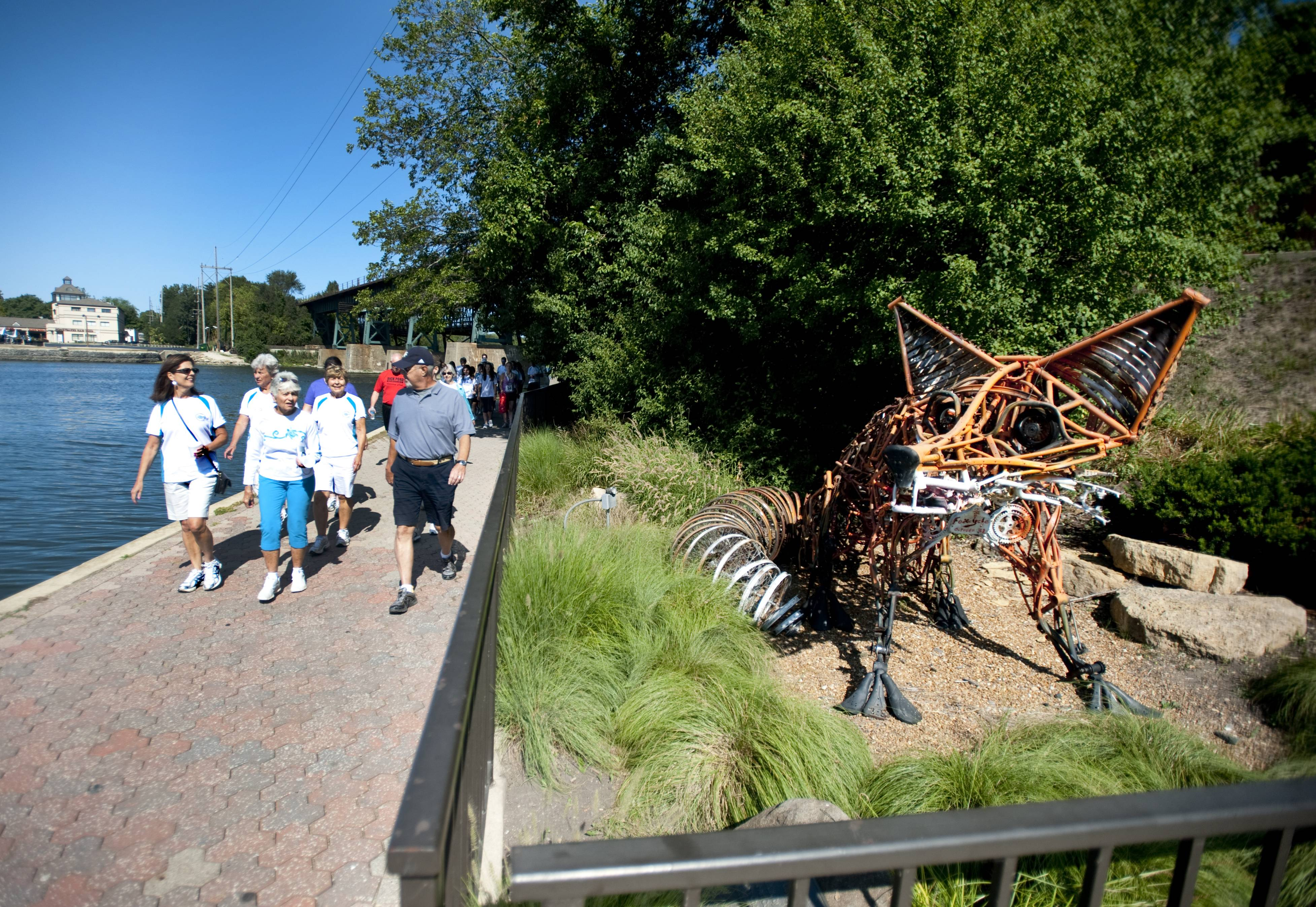 Participants in the walking portion of the Bob Leonard River Run/Walk can view sculptures in the park along the way.