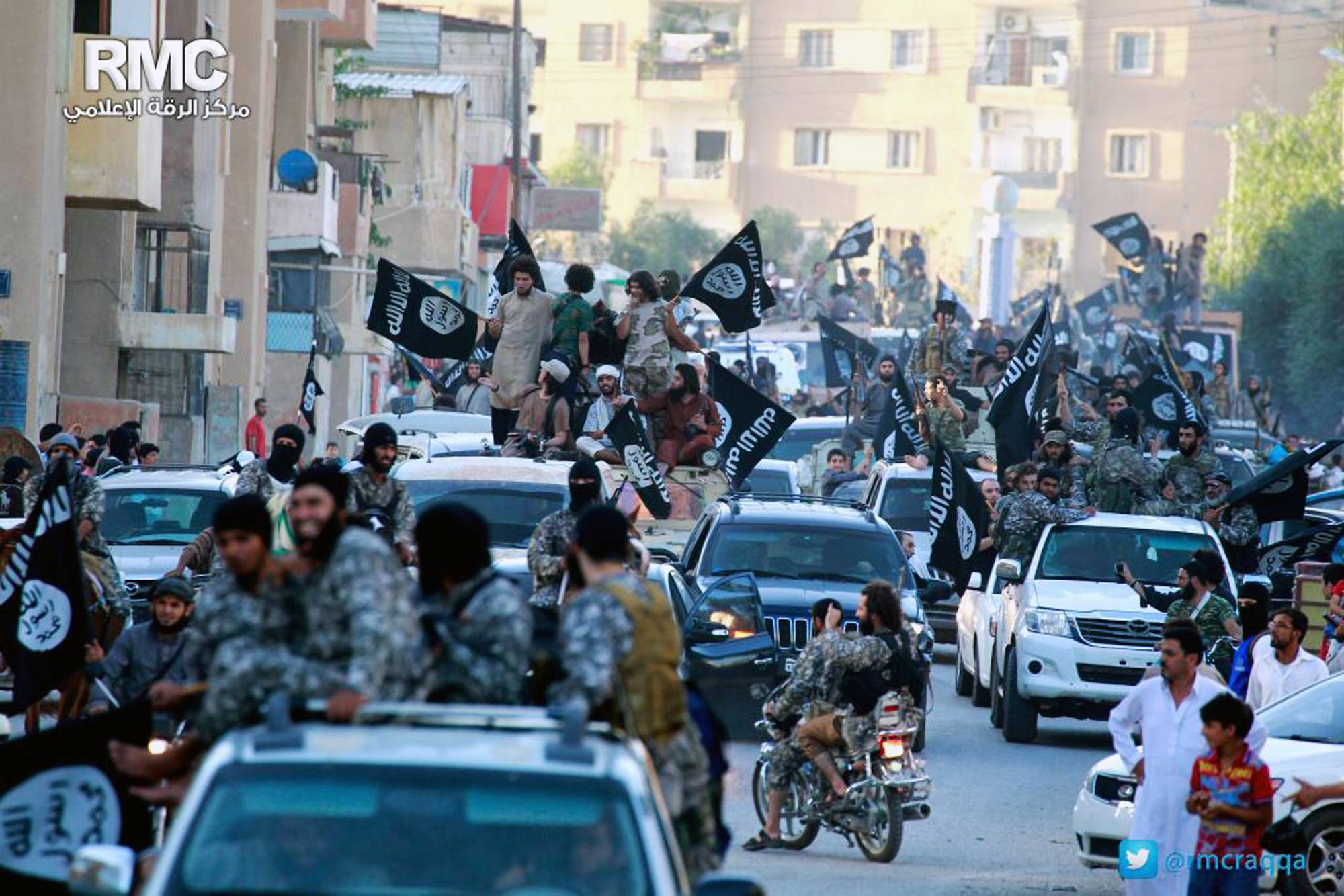 Fighters from extremist Islamic State group celebrate during a parade in Raqqa, Syria. Activists have reported two cases of stoning this month in the Syrian northern province of Raqqa. The first case of stoning occurred in the town of Tabqa. A day after the July 17 stoning of Shamseh Mohammed Abdullah, 26, Faddah al-Sayed Ahmad was stoned to death in the provincial capital of Raqqa.