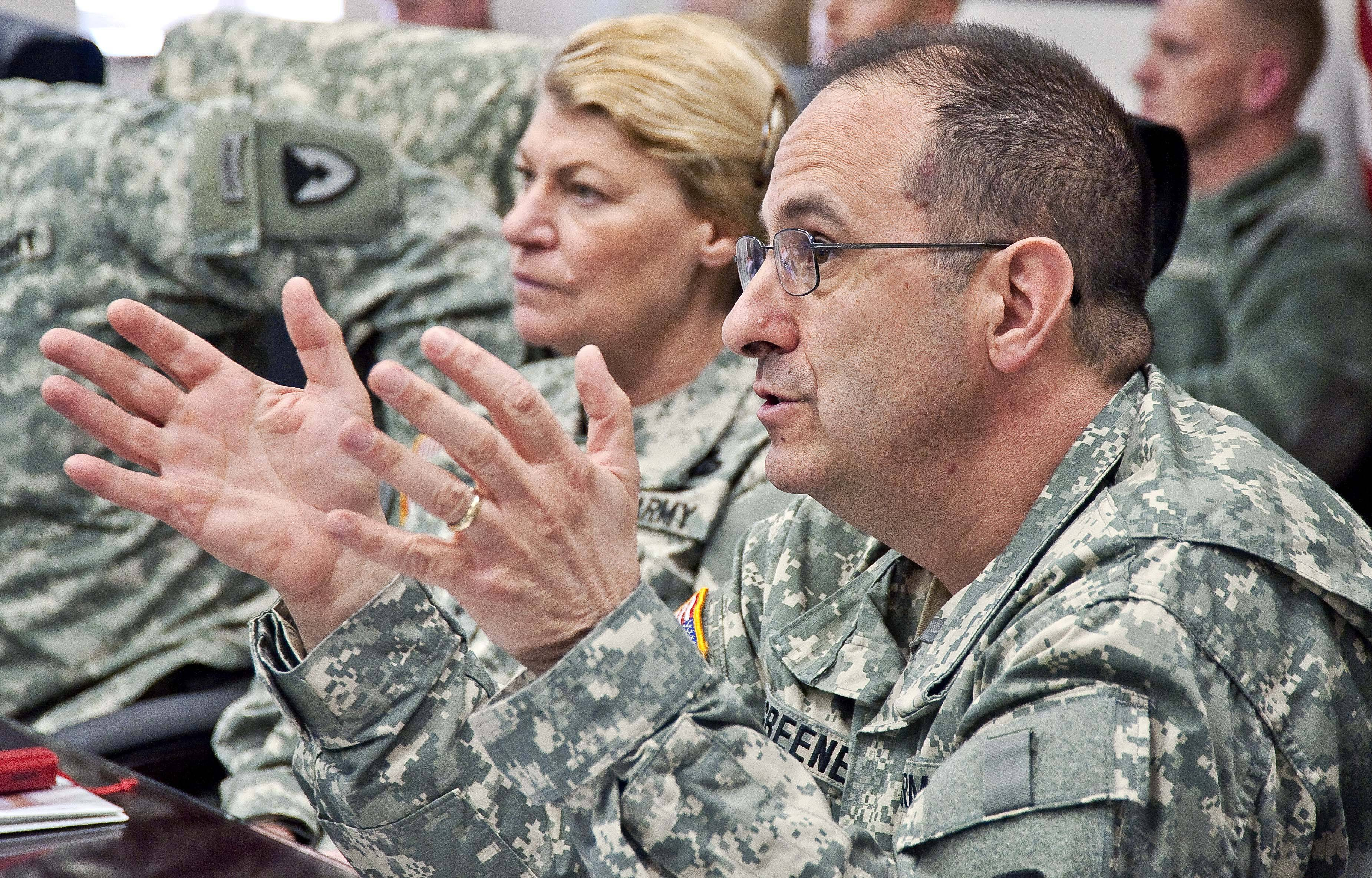 Brig. Gen. Harold Greene, right, speaks beside Gen. Ann Dunwoody at the Natick Soldier Systems Center in Natick, Mass.