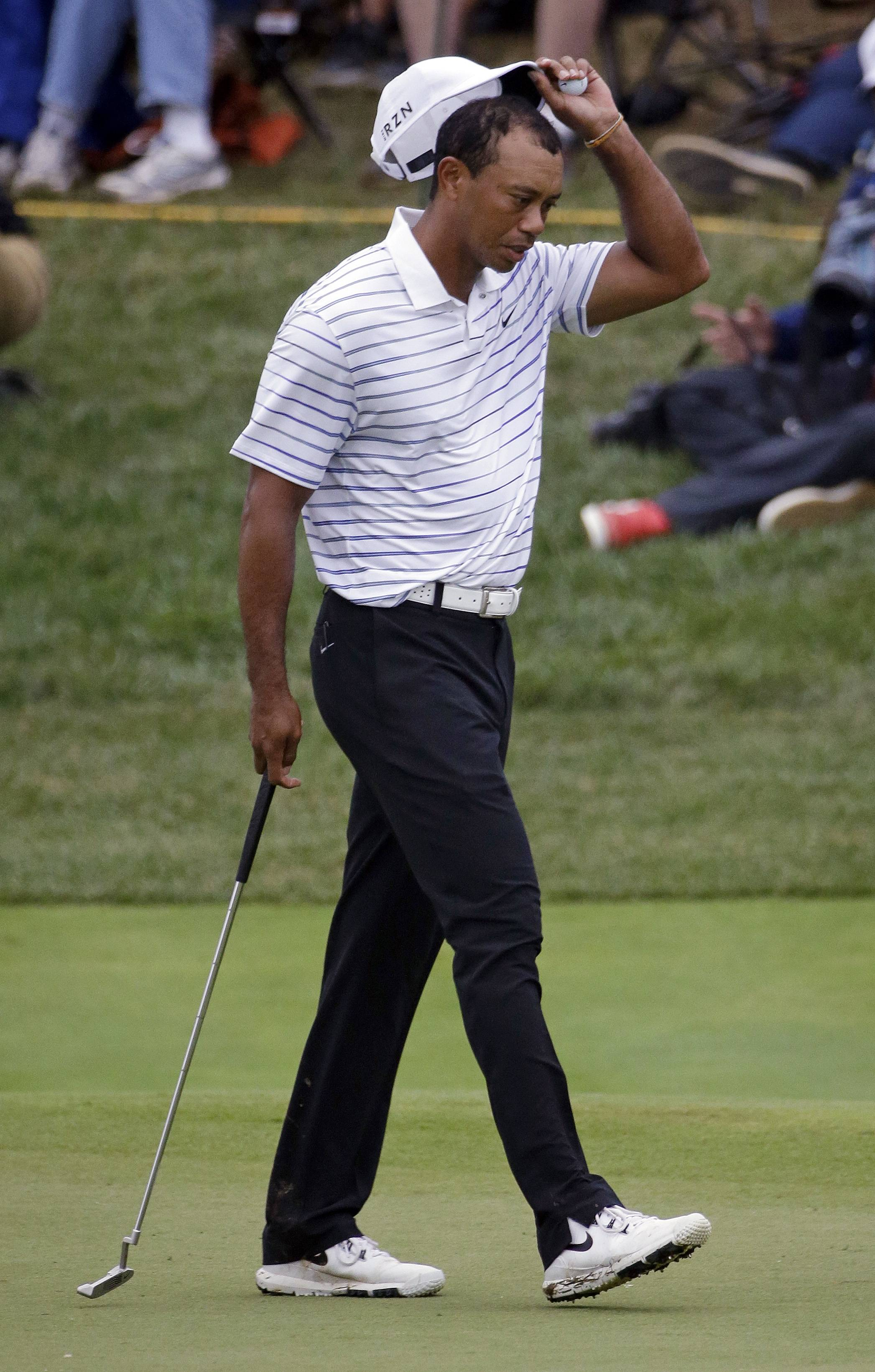 Tiger Woods walks up the 18 green during the second round of the PGA Championship golf tournament at Valhalla Golf Club on Friday, Aug. 8, 2014, in Louisville, Ky.