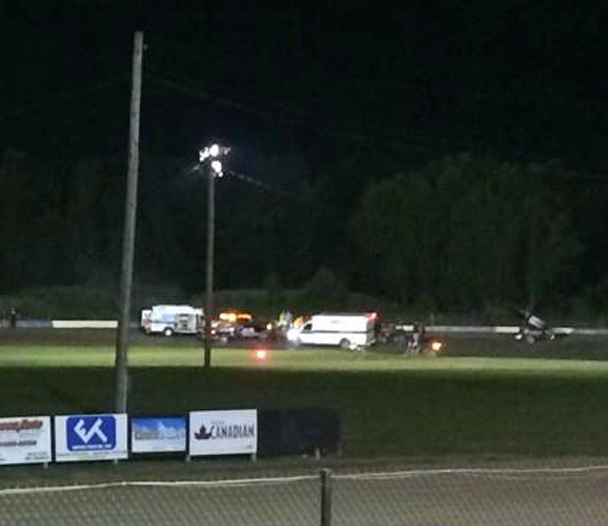 Ambulances on the scene at Canandaigua Motorsports Park on Saturday in Canandaigua, N.Y. NASCAR driver Tony Stewart struck and killed a sprint car driver who had climbed from his car and was on the track trying to confront Stewart during a race in upstate New York on Saturday night.