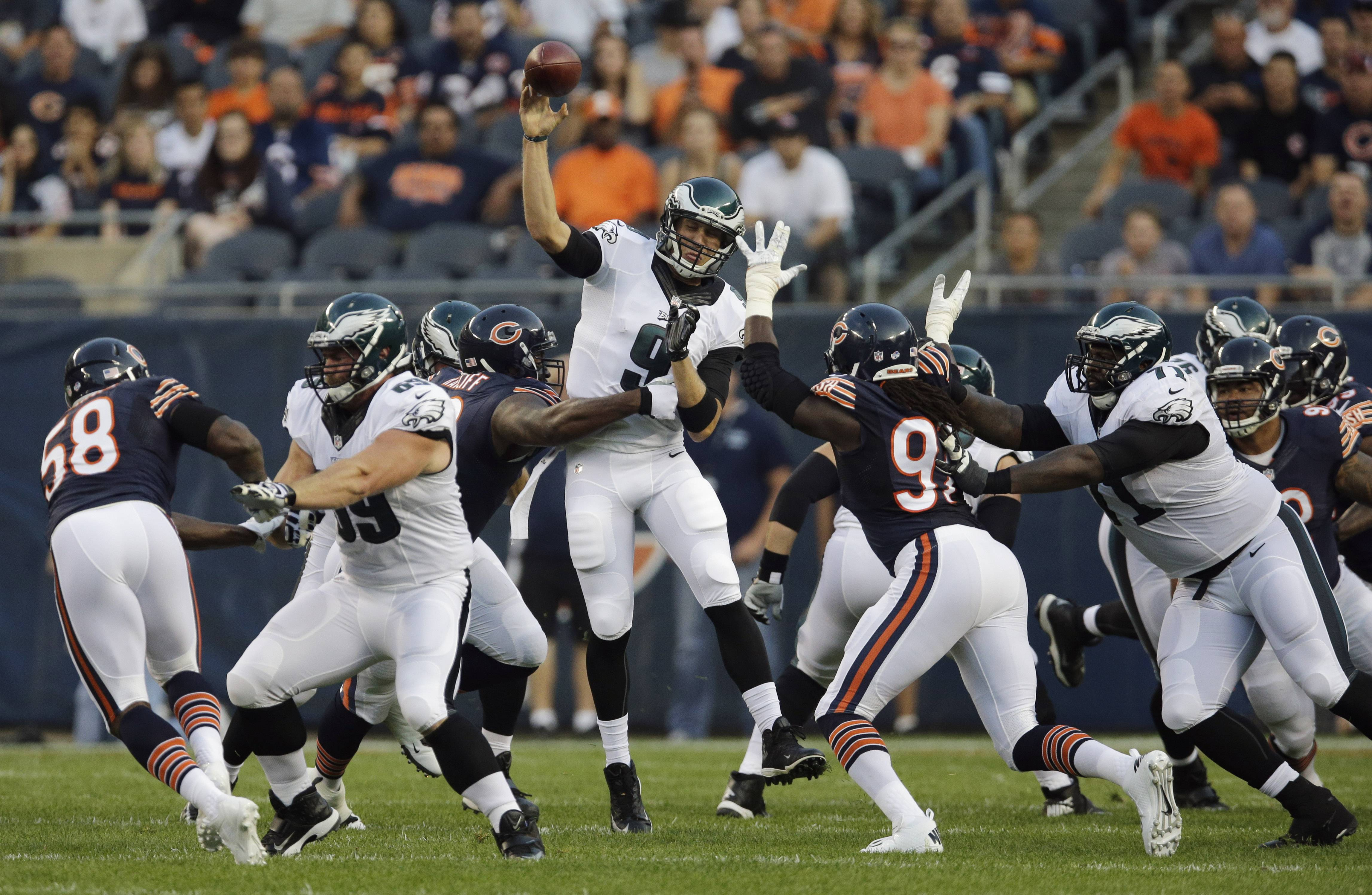 Eagles quarterback Nick Foles throws a pass under pressure from Bears defensive tackle Jeremiah Ratliff during Friday's preseason opener at Soldier Field.