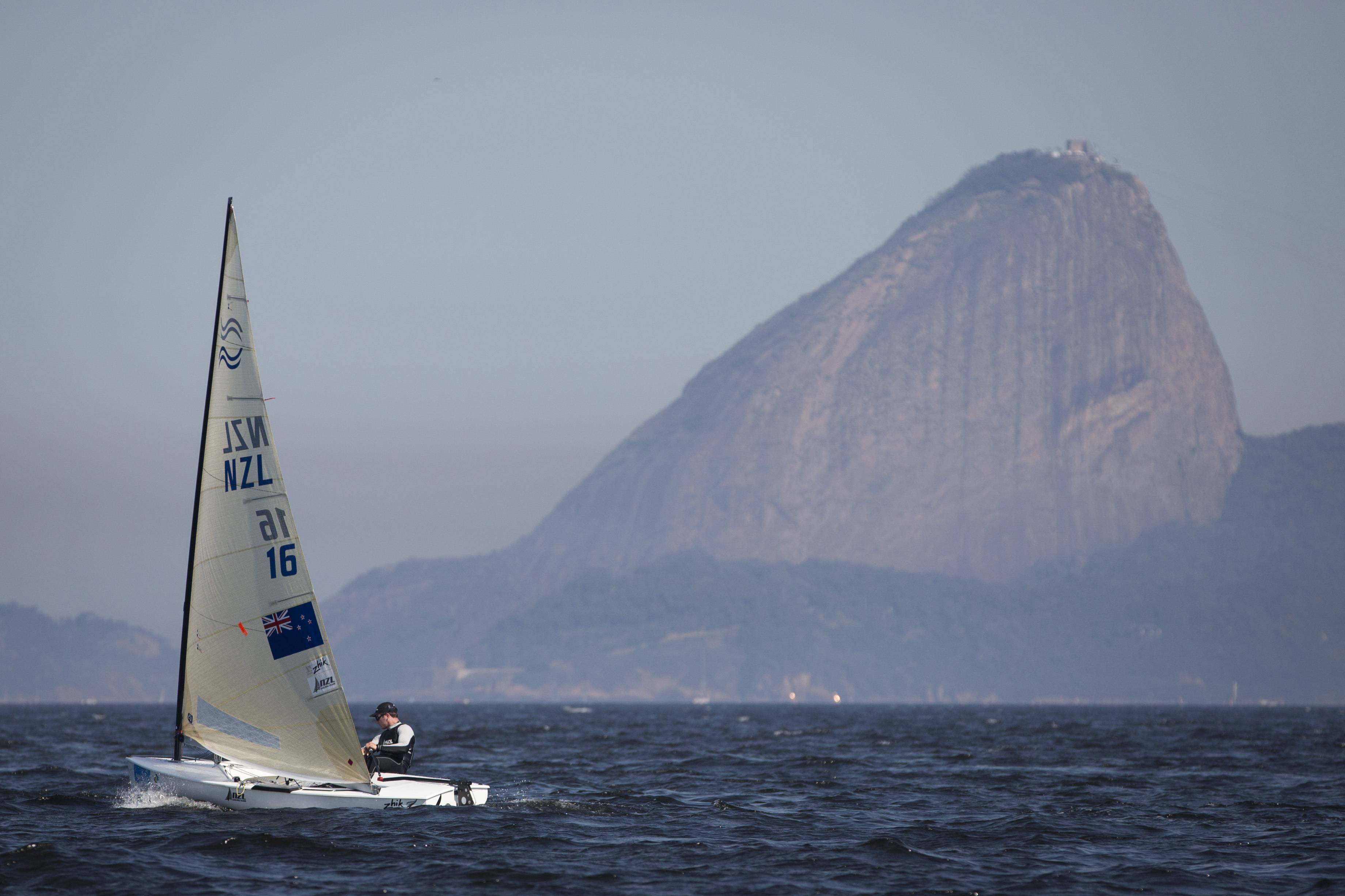 New Zealand's Finn class Andrew Murdoch competes during the first test event for the Rio 2016 Olympic Games at the Guanabara Bay in Rio de Janeiro, Sunday, Aug. 3, 2014. Sugar Loaf Mountain is seen on the background. American sailing officials have hired medical experts to test the water in Guanabara, which has suffered from decades of untreated human waste being poured into the bay.