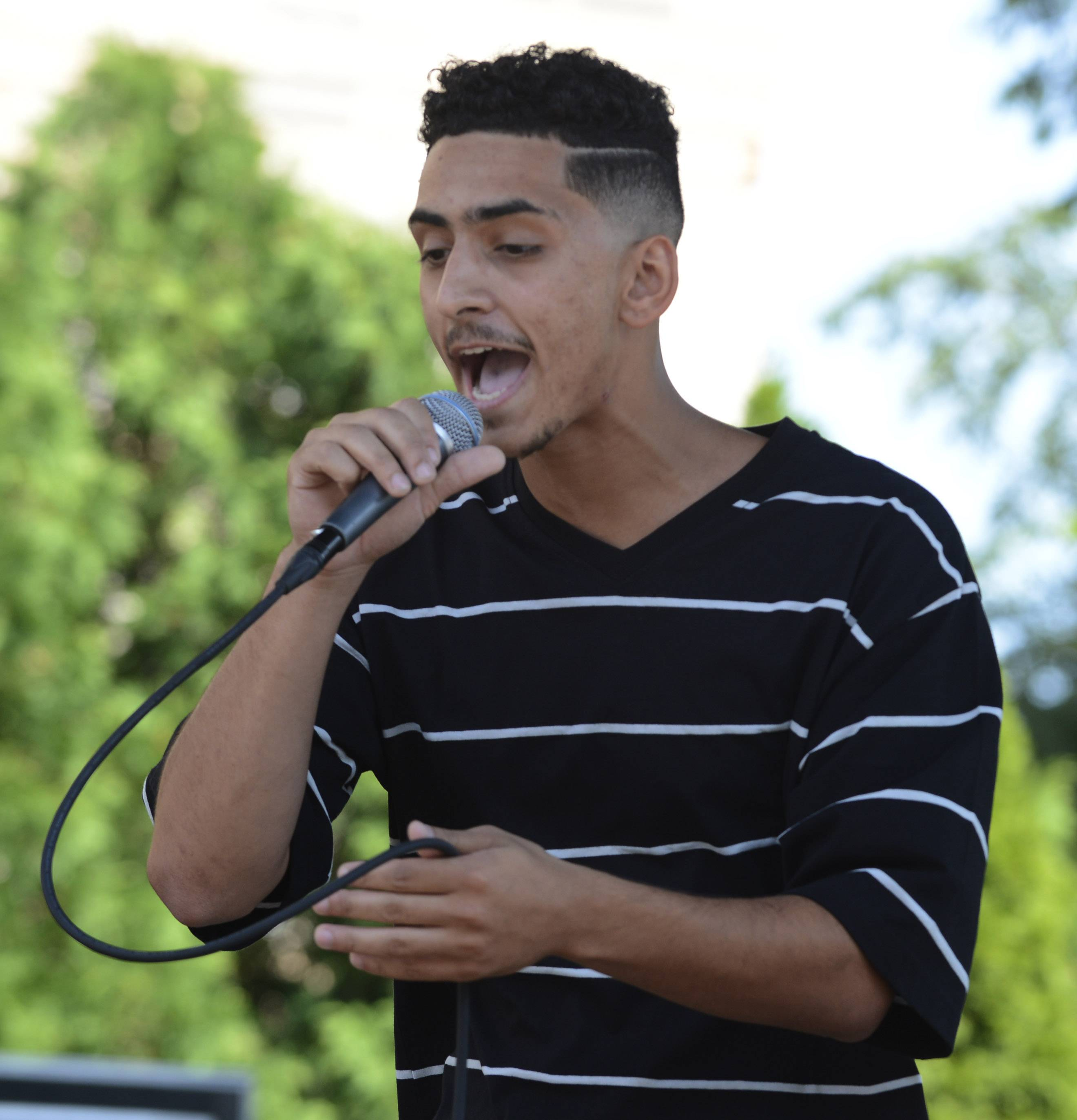 Jordan Madonia, aka Jaooo, of Hoffman Estates performs Saturday during the Suburban Chicago's Got Talent finale in Arlington Heights.