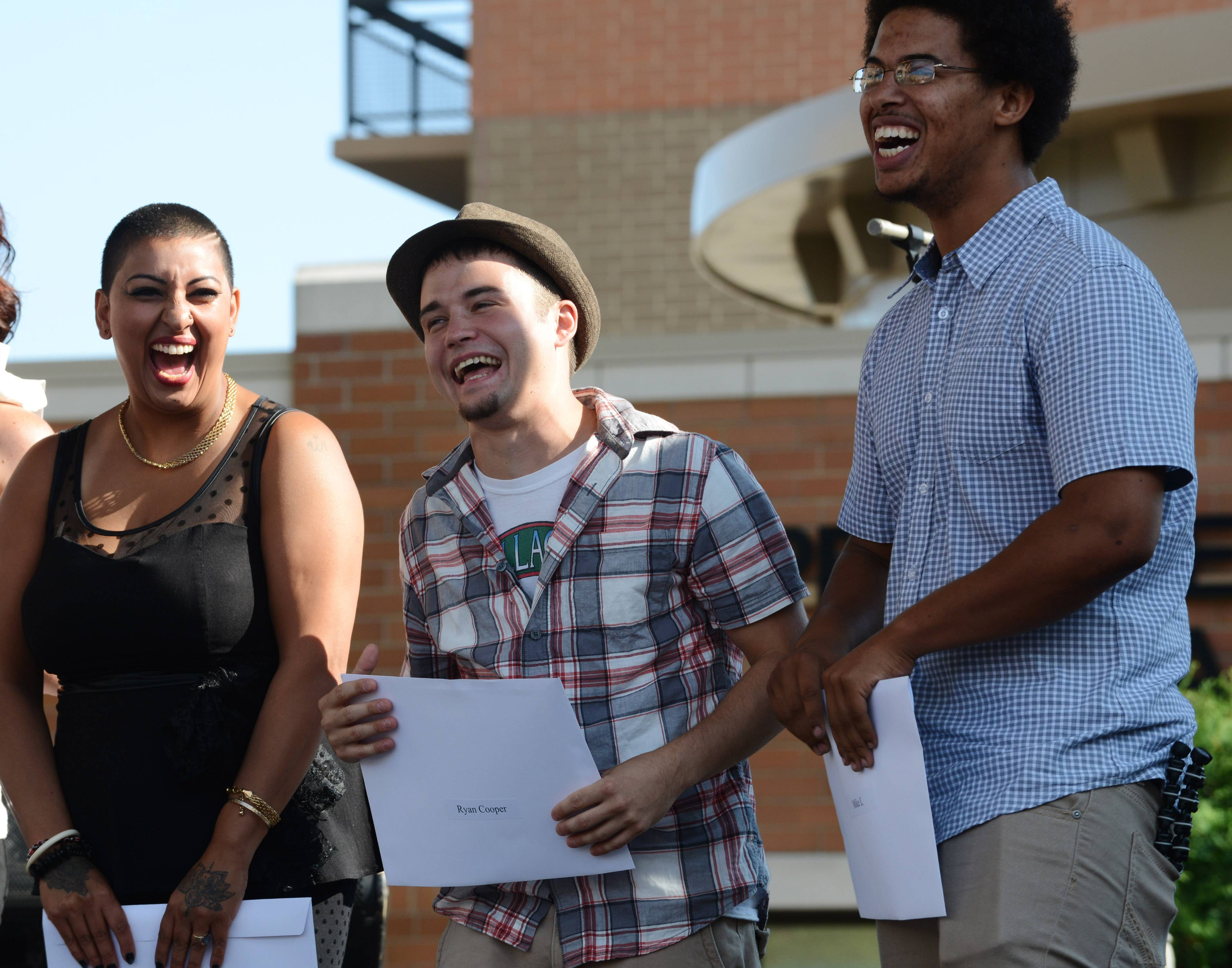 Contestants, from left, Farah Morales of Mount Prospect, Ryan Cooper of Schaumburg and Michael Lueck of Des Plaines stand to get onstage during the Suburban Chicago's Got Talent competition at Saturday's finale in Arlington Heights.