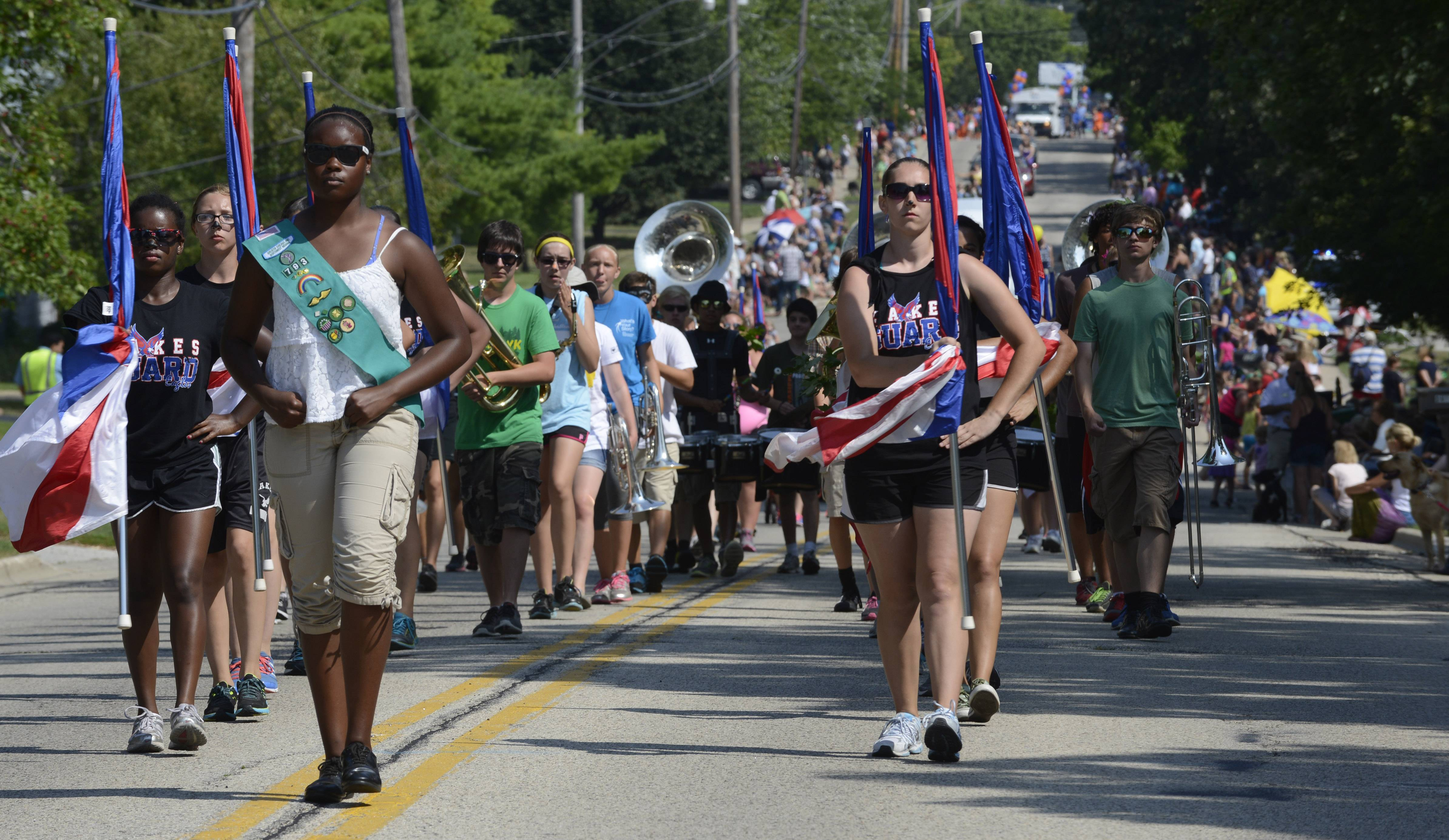 The Lakes High School drill team and band matches Saturday during the Lindenfest Parade in Lindenhurst.