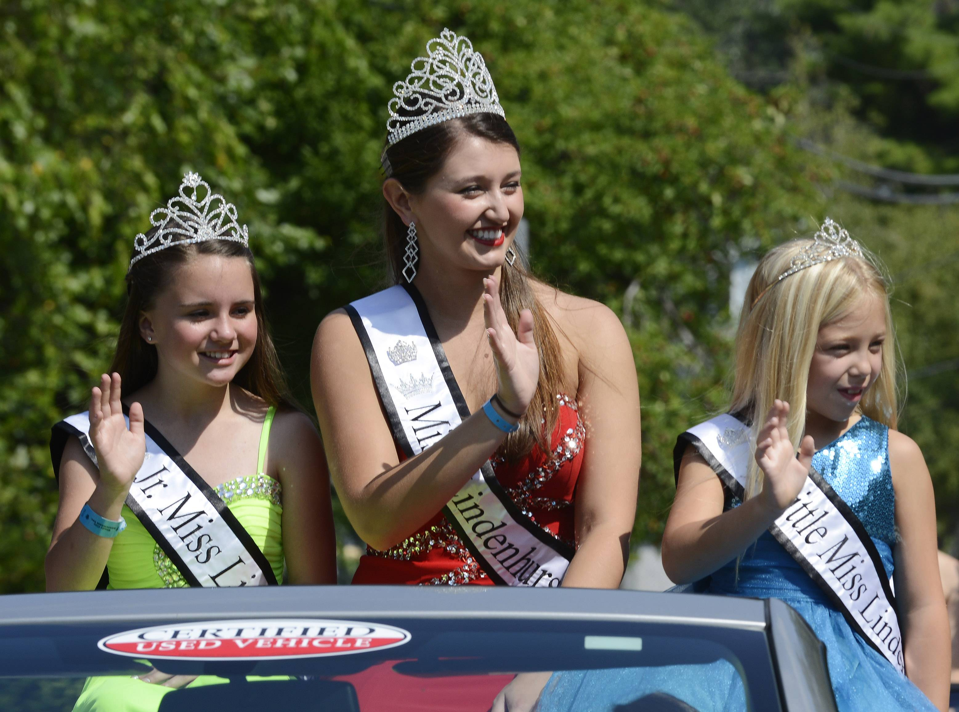 Left to right, Junior Miss Lindenhurst Lilly Burdette, Miss Lindenhurst Megan Wayne and Little Miss Lindenhurst Emma Palmer ride Saturday in the Lindenfest Parade in Lindenhurst.