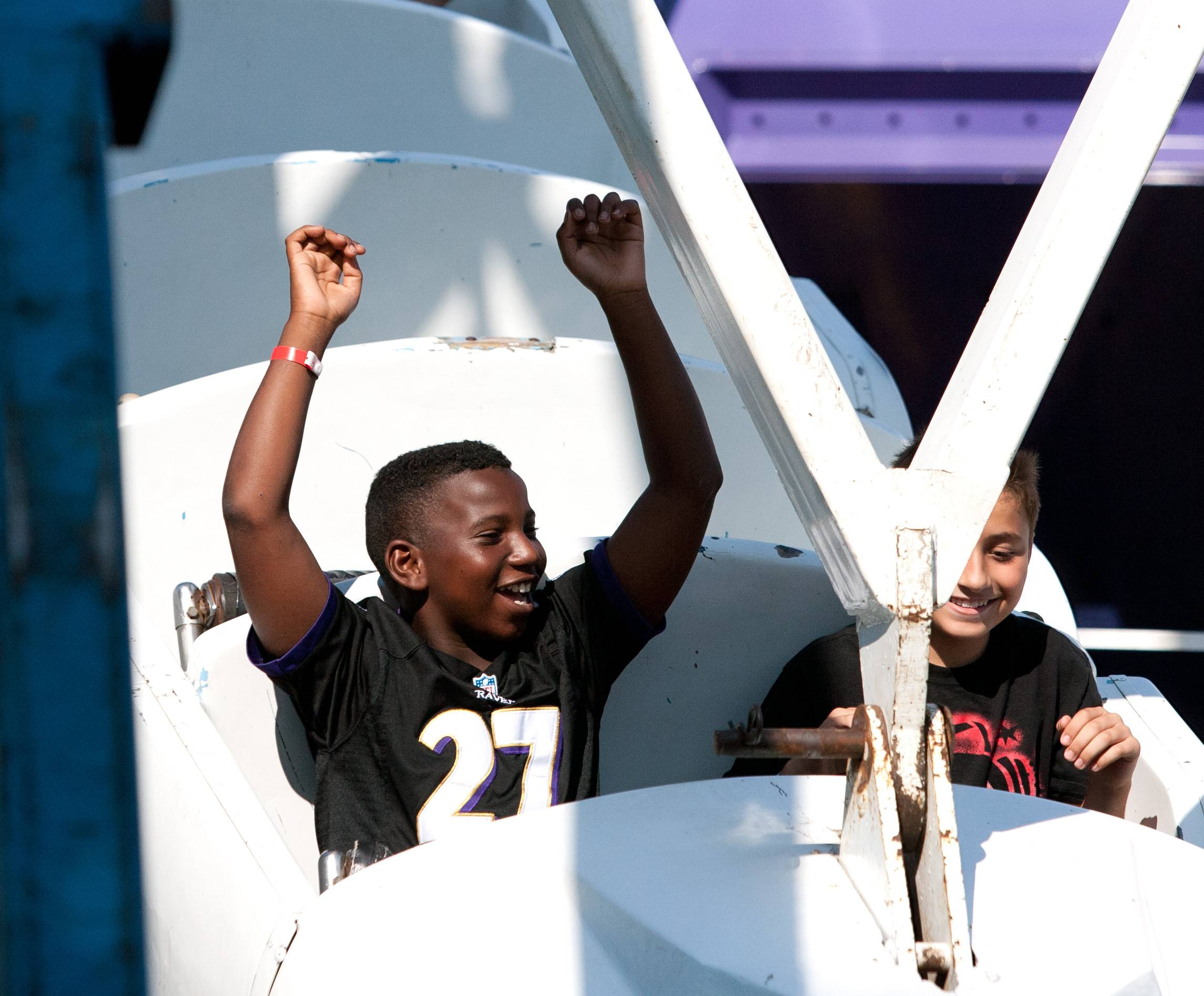 AJ Howard, left, and Aiden Suarez, both 11 and from Wood Dale, enjoy a carnival ride during Wood Dale's Prairie Fest celebration Saturday.