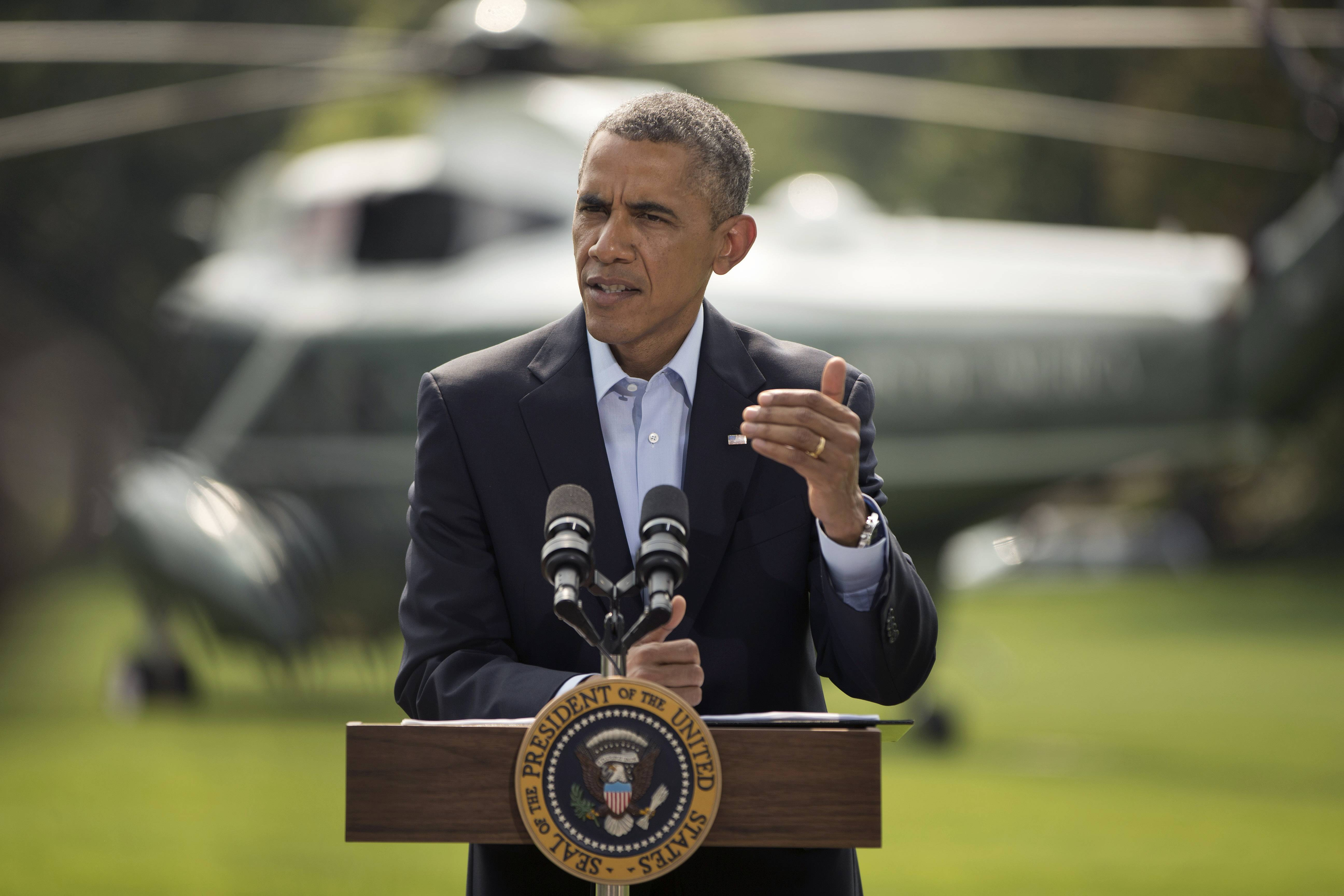 President Barack Obama speaks on the South Lawn of the White House in Washington, Saturday, Aug. 9, 2014, about ongoing situation in Iraq before his departure on Marine One for a vacation in Martha's Vineyard. Obama announced late Thursday that he had ordered military airstrikes in northern Iraq to hold off Islamic State forces advancing on the Kurdish capital of Irbil. Obama also ordered airdrops of food and water to member of a religious minority group who fled into the mountains to escape the militants.
