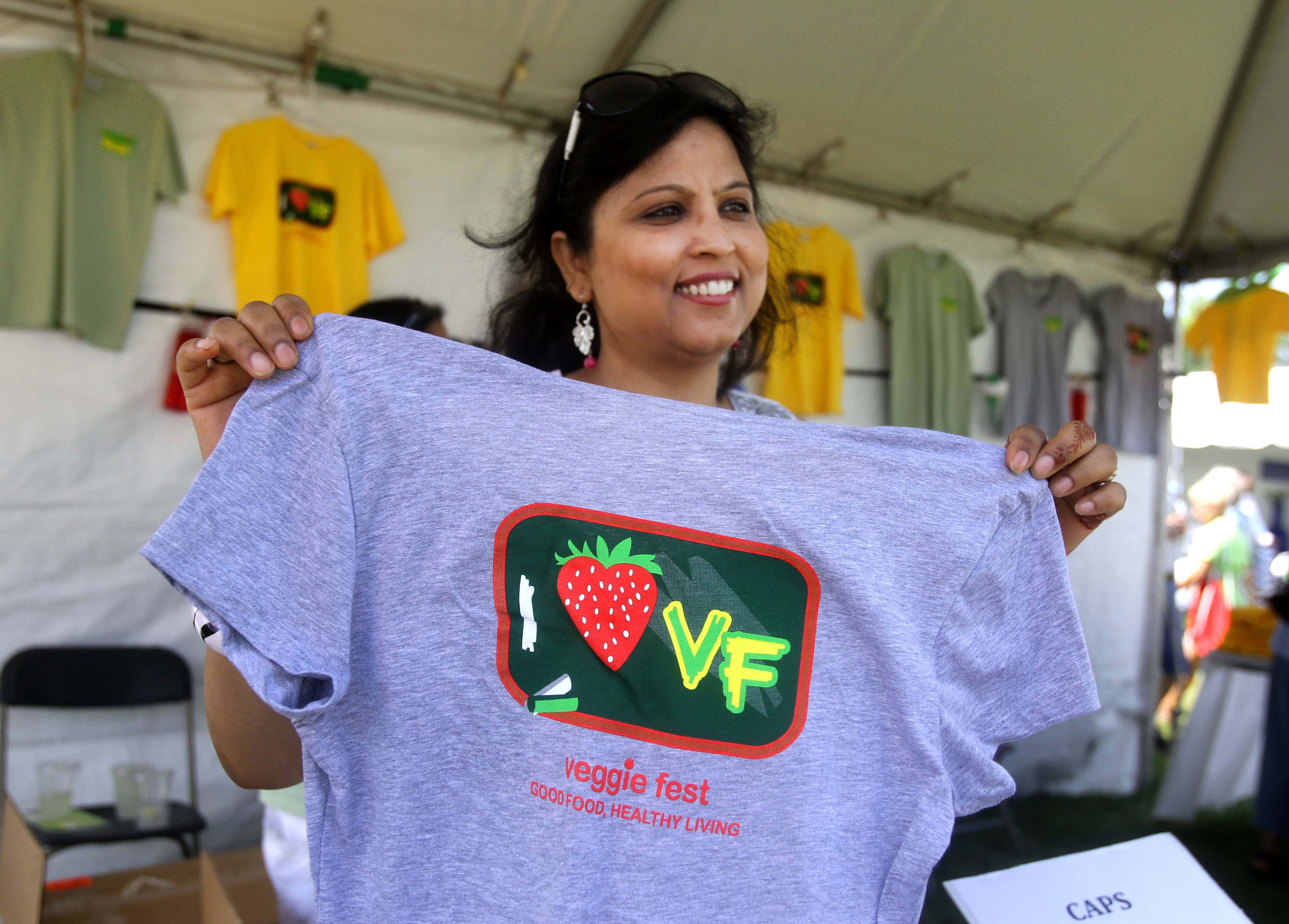 Rajendra Pandey sells T-shirts during Veggie Fest, held Saturday and Sundya on the grounds of the Science of Spirituality Meditation Center in Naperville. Pandey was one of 800 volunteers involved in implementing this ninth annual celebration.