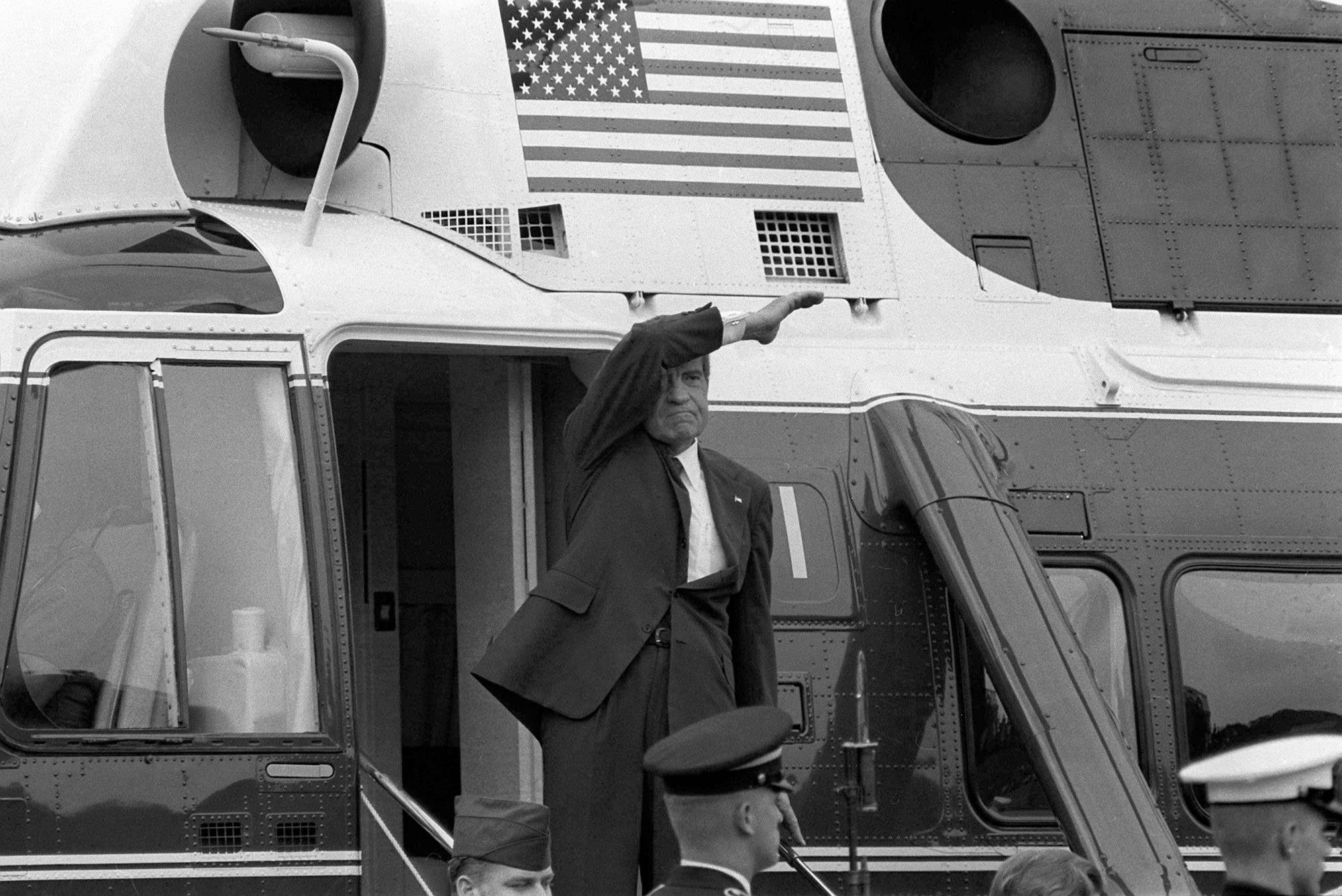 On the day of his resignation, Aug. 9, 1974, Richard M. Nixon waves goodbye from the steps of his helicopter as he leaves the White House following a farewell address to his staff. The Watergate scandal forced Nixon to become the first U.S. president to resign from office.