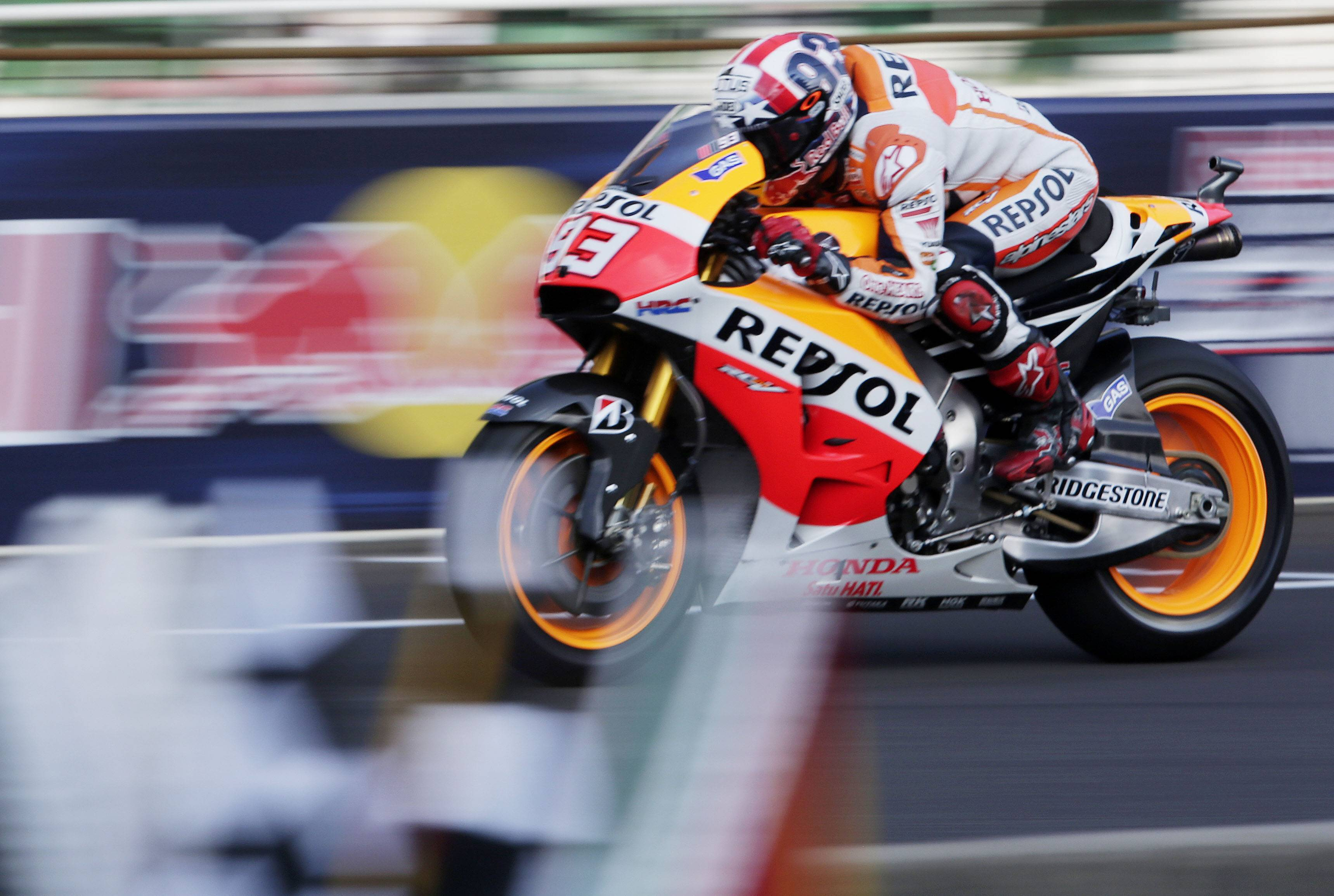 Marc Marquez, of Spain, rides down the front straight during the third practice for the Indianapolis Moto GP motorcycle race at the Indianapolis Motor Speedway in Indianapolis, Saturday, Aug. 9, 2014.