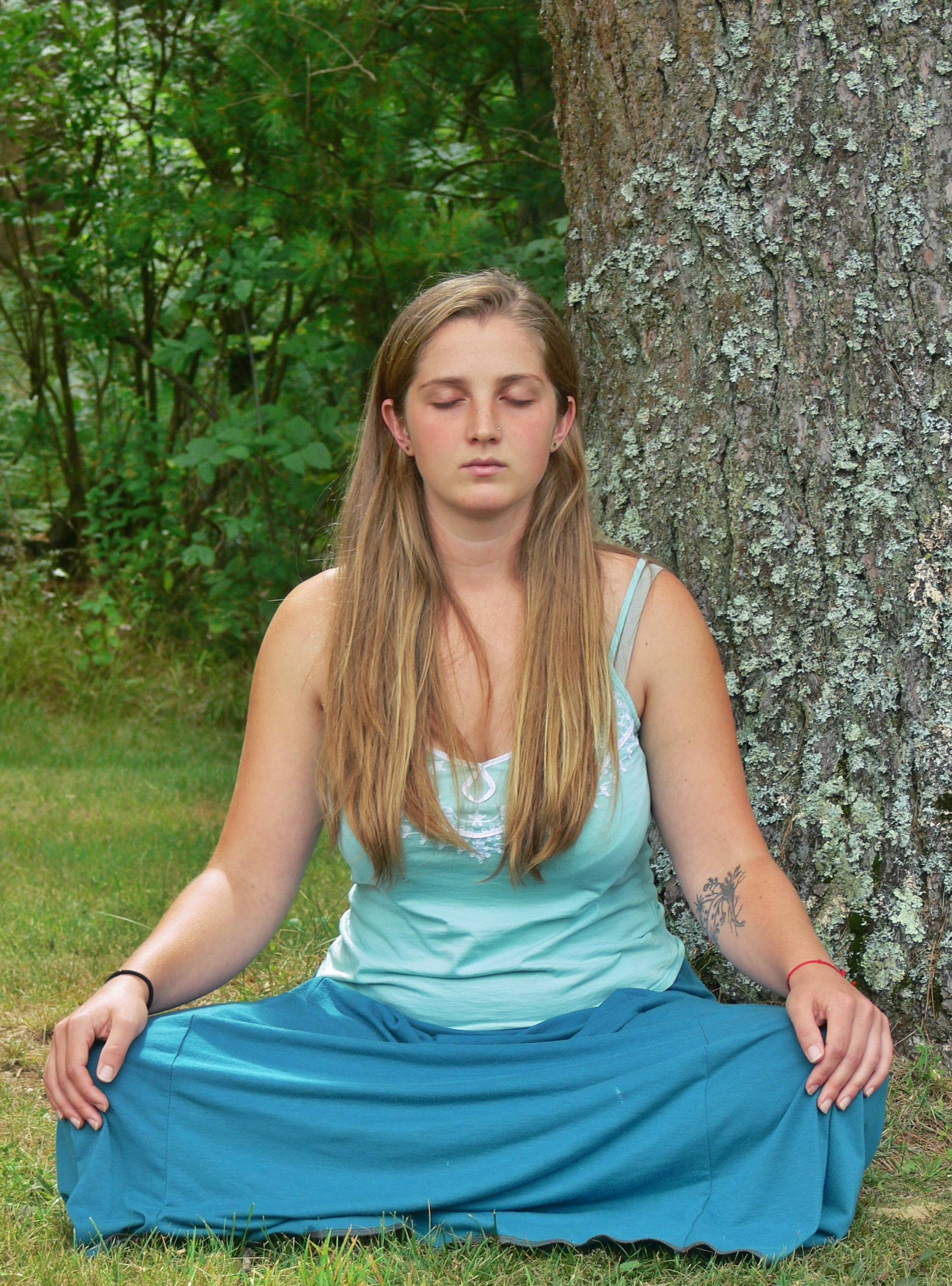 A woman sits in meditation on the grounds of the Insight Meditation Society Retreat Center in Barre, Mass. The Buddhist-influenced center offers silent retreats that allow individuals to take a break from the stresses and demands of daily modern life.