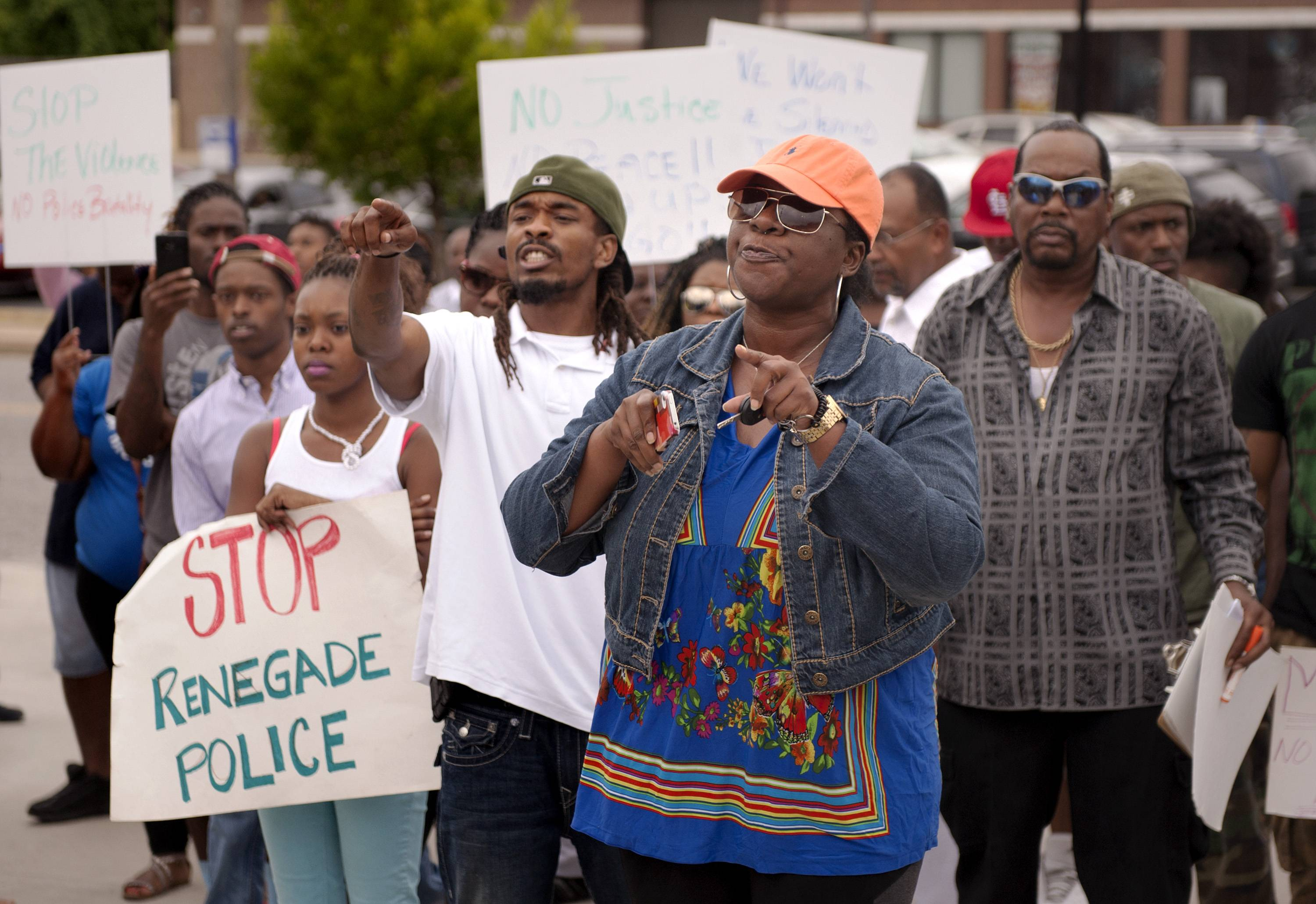Protestors confront police during an impromptu rally Sunday to protest the shooting of Michael Brown, 18, by police in Ferguson, Mo., Saturday.