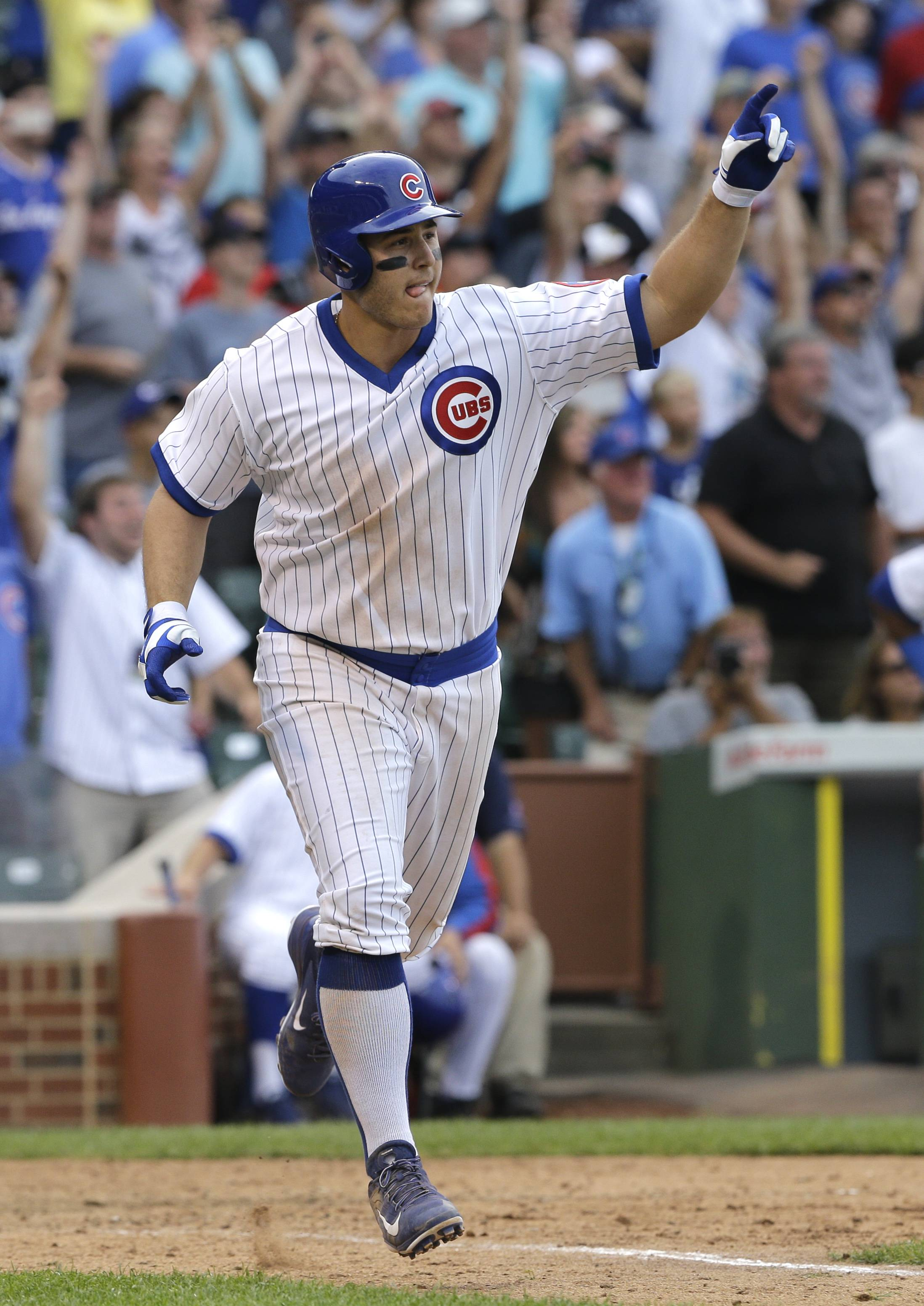Anthony Rizzo celebrates after hitting a game-winning single for the Cubs during the 12th inning Sunday against Tampa Bay Rays at Wrigley Field. The Cubs won 3-2.