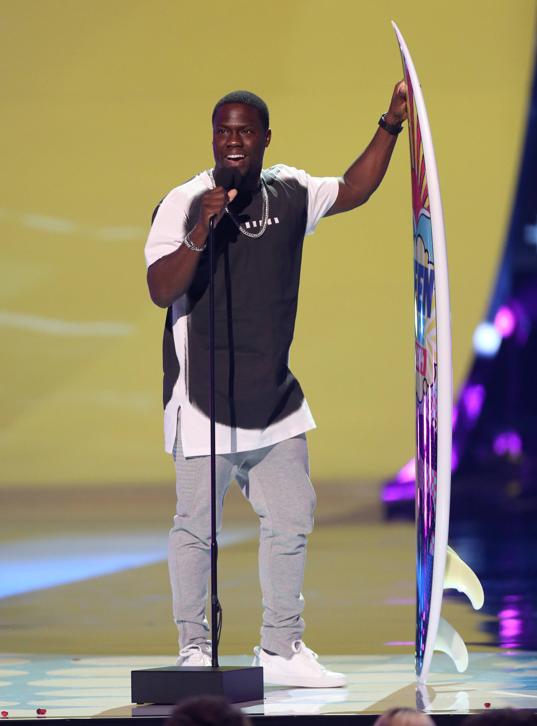"Kevin Hart accepts the award for choice movie actor: comedy for ""Ride Along"" at the Teen Choice Awards at the Shrine Auditorium on Sunday in Los Angeles."