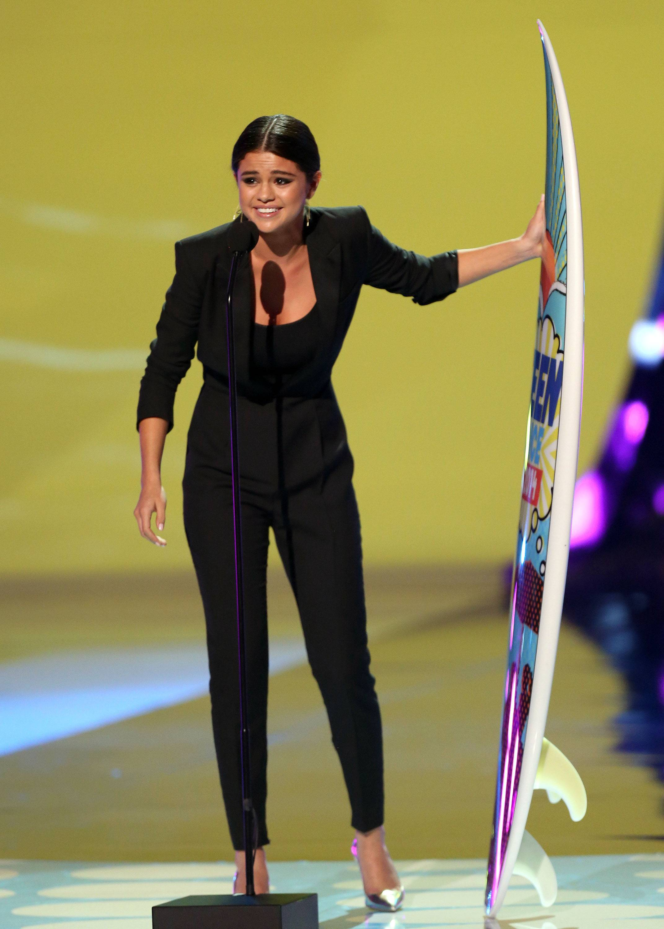 Selena Gomez accepts the award for ultimate choice at the Teen Choice Awards at the Shrine Auditorium on Sunday in Los Angeles.