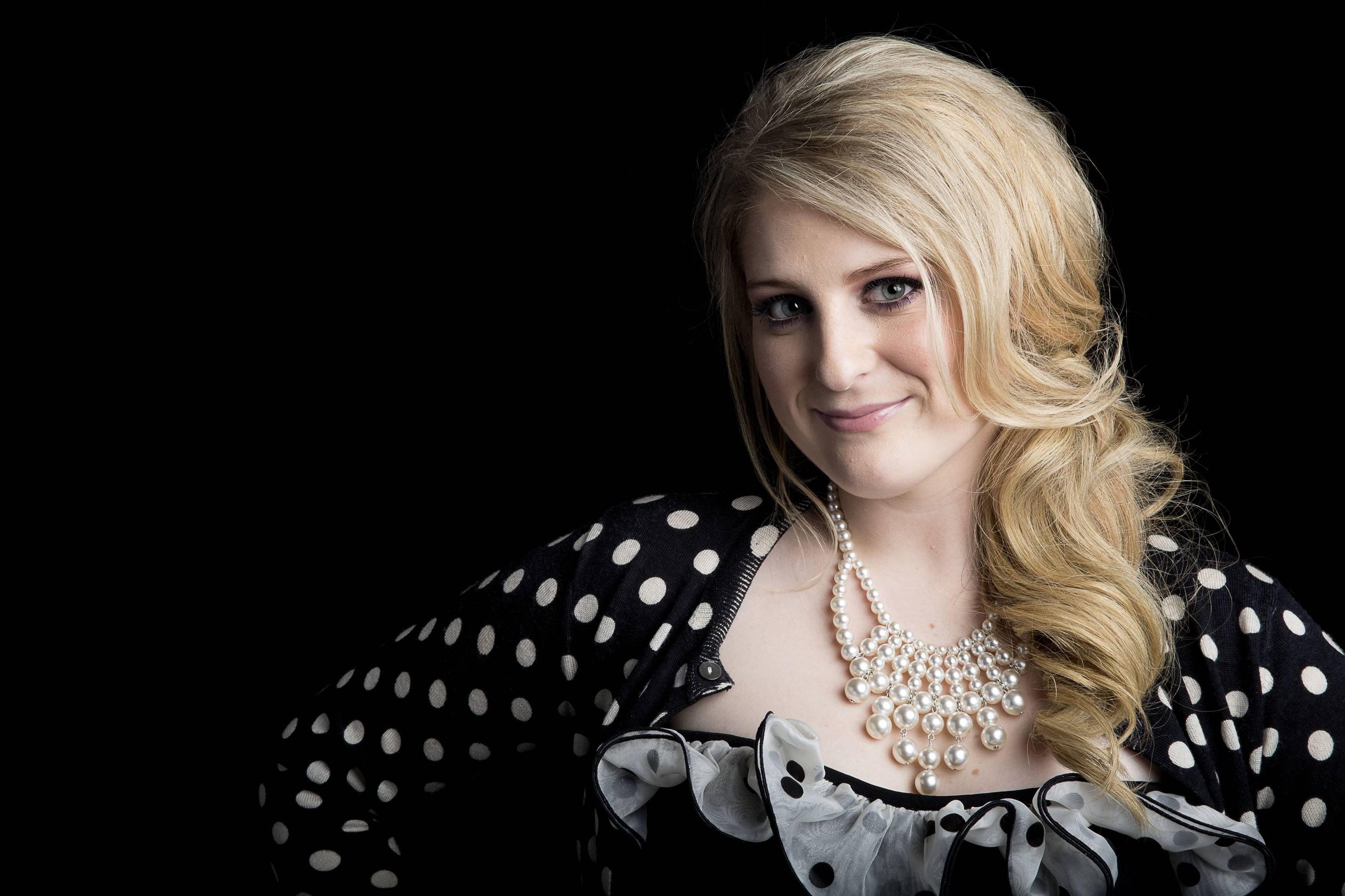 "American singer-songwriter Meghan Trainor, 20, is having a pop culture moment with the pop single ""All About That Bass."""