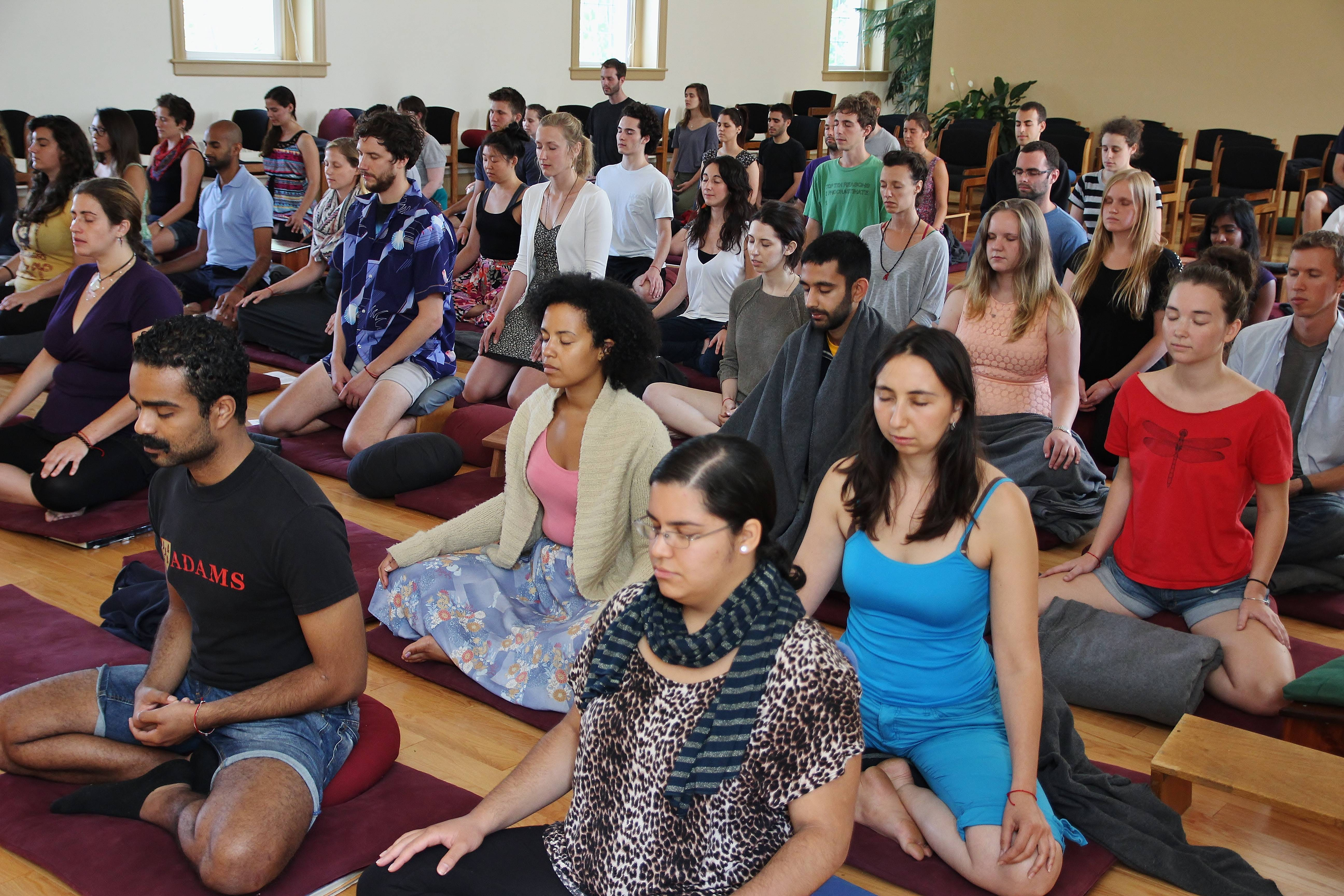 A group takes a class in meditation instruction in the Insight Meditation Society Retreat Center meditation hall.