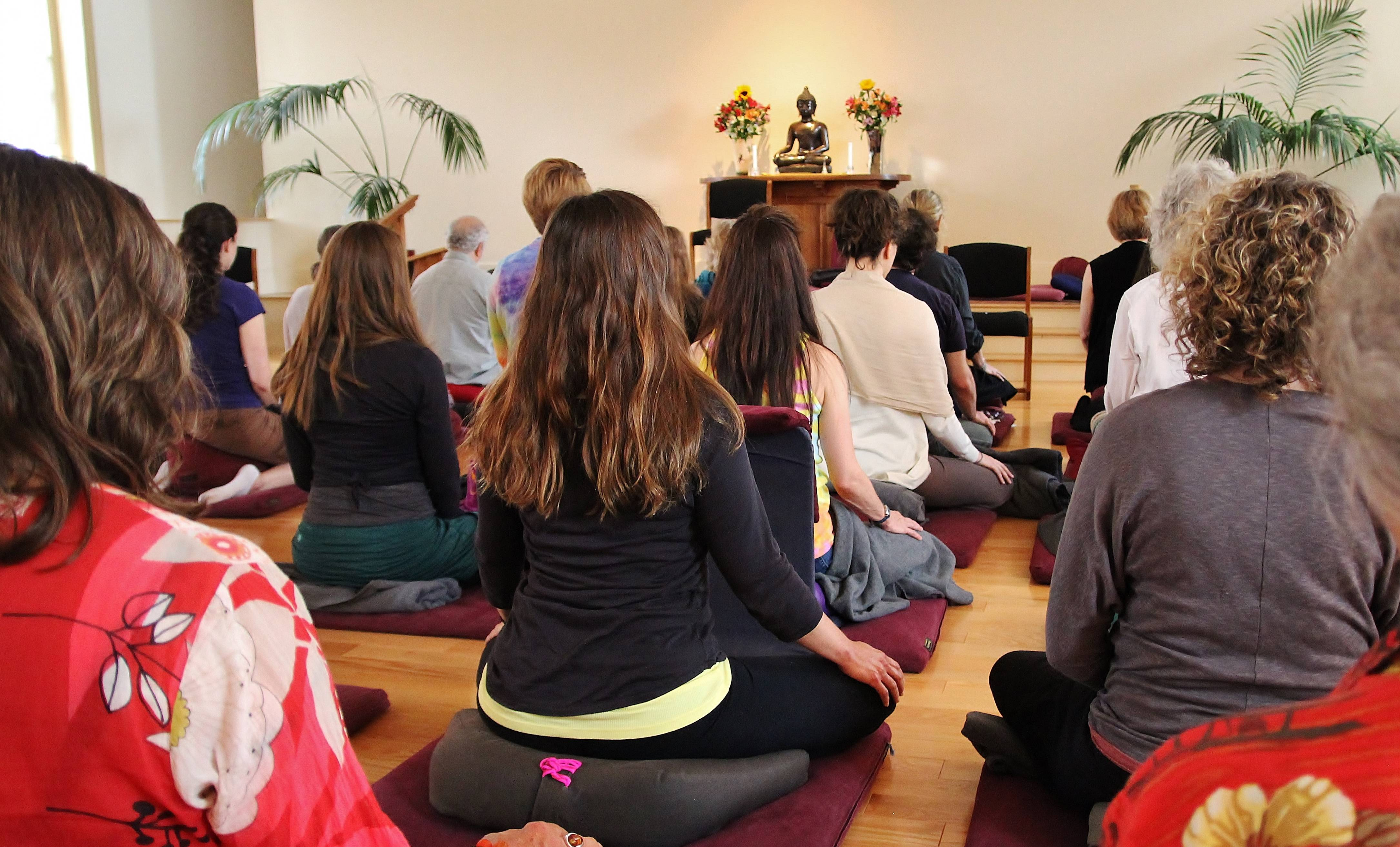 A group meditates at the Insight Meditation Society. At the Barre, Mass., center, there are set times for sitting, walking, yoga, working and eating.