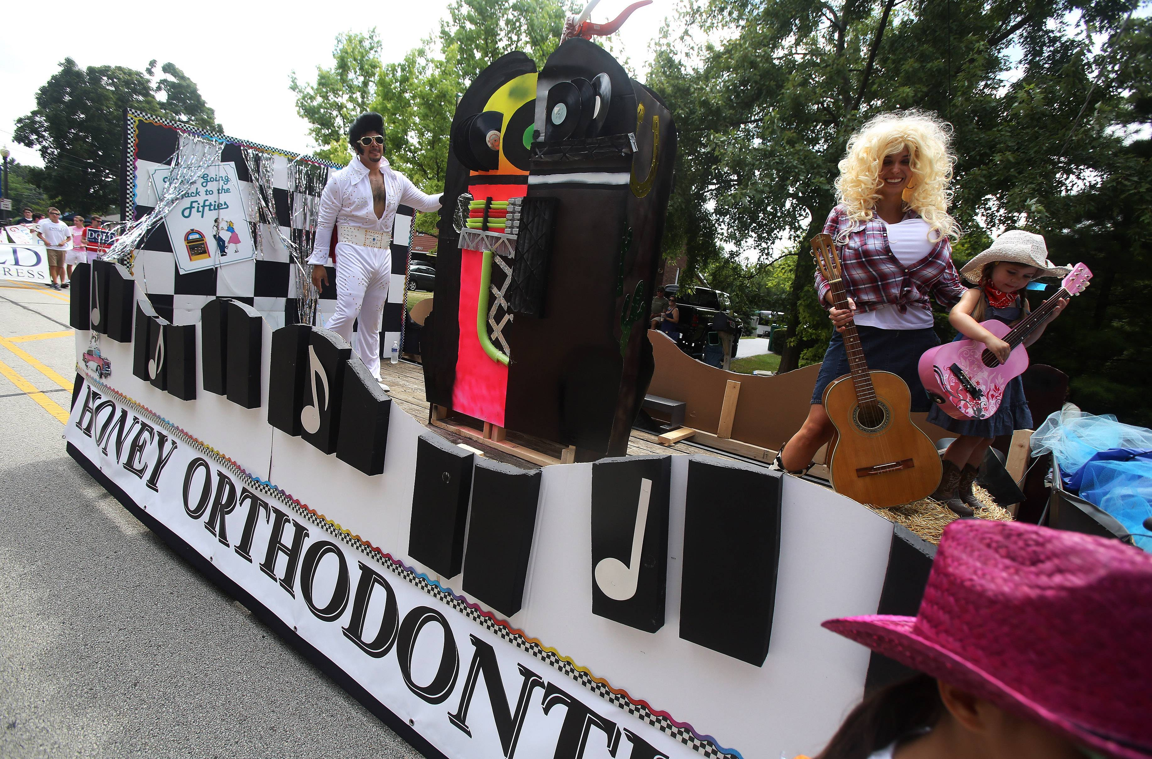"Characters representing Elvis and Dolly Parton make up the Honey Orthodontics float during the Gurnee Days parade Sunday along Old Grand Ave. This year's parade theme was ""A Lil' Bit of Country, A Lil' Bit of Rock and Roll."""