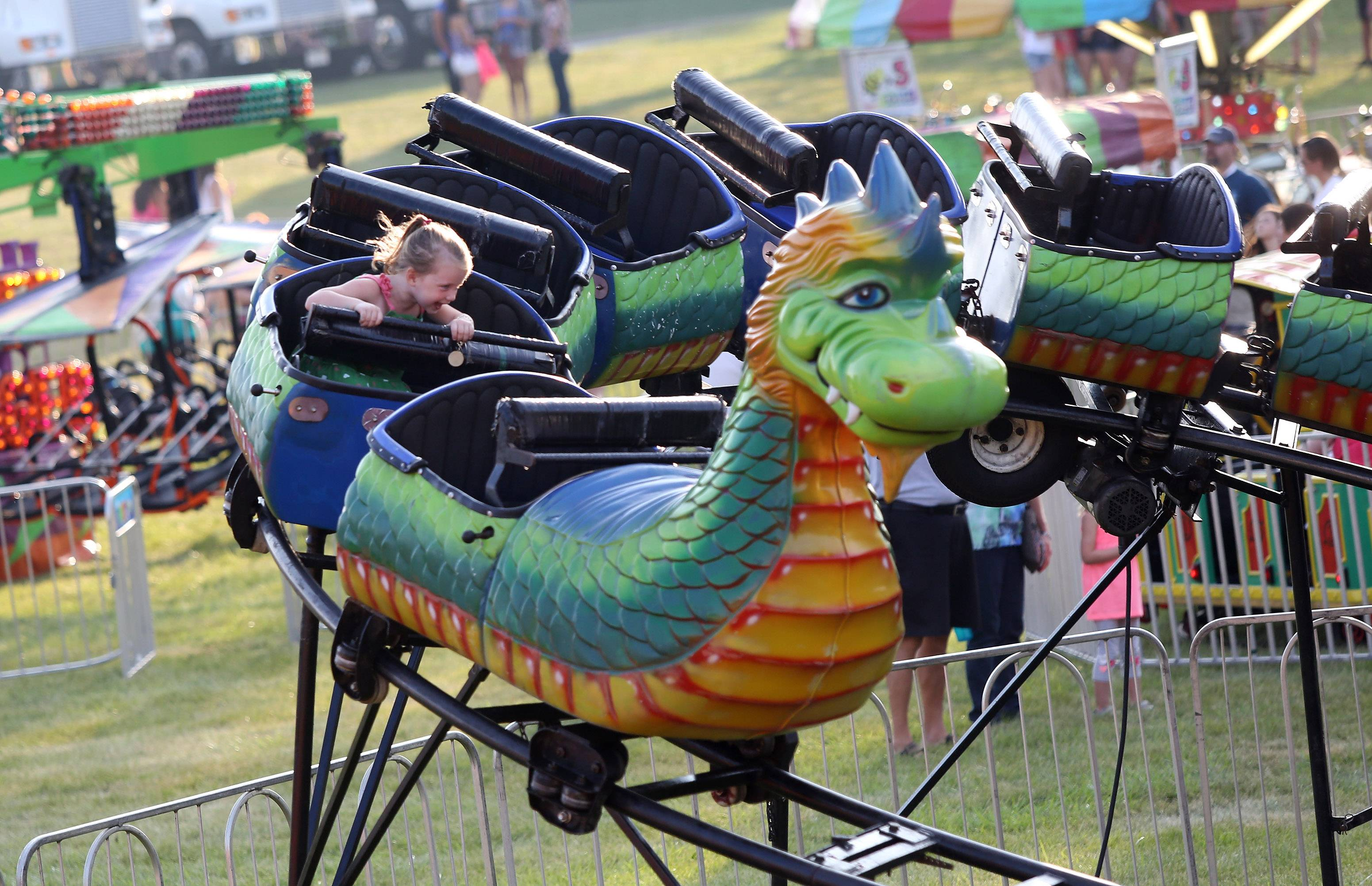 Four-year-old Brooklyn Chase of Lindenhurst has the Dragon Wagon all to herself during the first day of Lindenfest 2014 Thursday at the Lindenhurst Village Hall grounds. The evening featured Miss, Jr. Miss and the Little Miss Lindenhurst pageants, bingo, carnival rides and food tents.