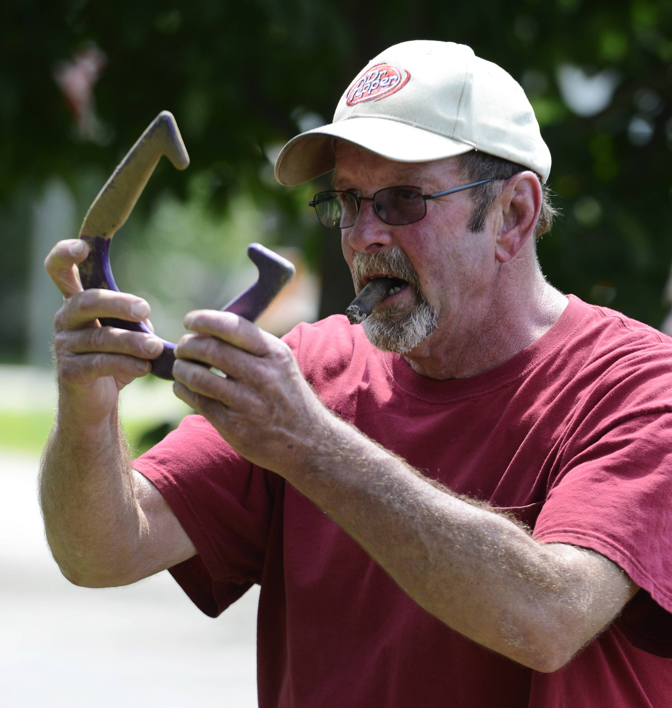 "Jimmy Nielsen of Lilymoor takes aim while playing in the horseshoe tournament during Lakemoorfest at Morrison Park in Lakemoor on Saturday. ""I come here every year, this is so much fun,"" Nielsen said. ""I took third in 1999."""