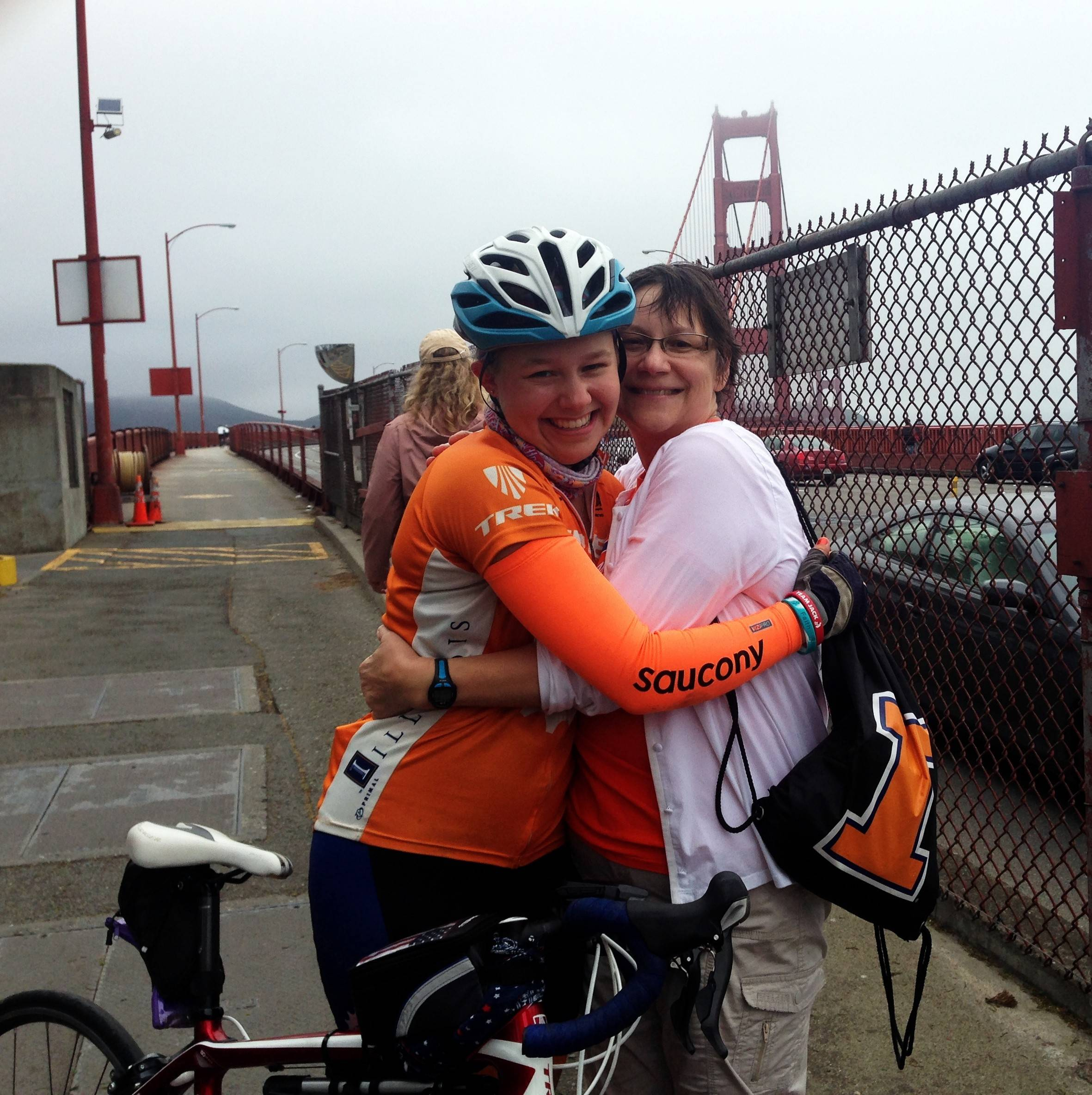 Grace Deetjen of Naperville embraces her mom, Kim, after Grace and a team from the University of Illinois bicycled roughly 4,000 miles across the U.S. to raise money for cancer research.