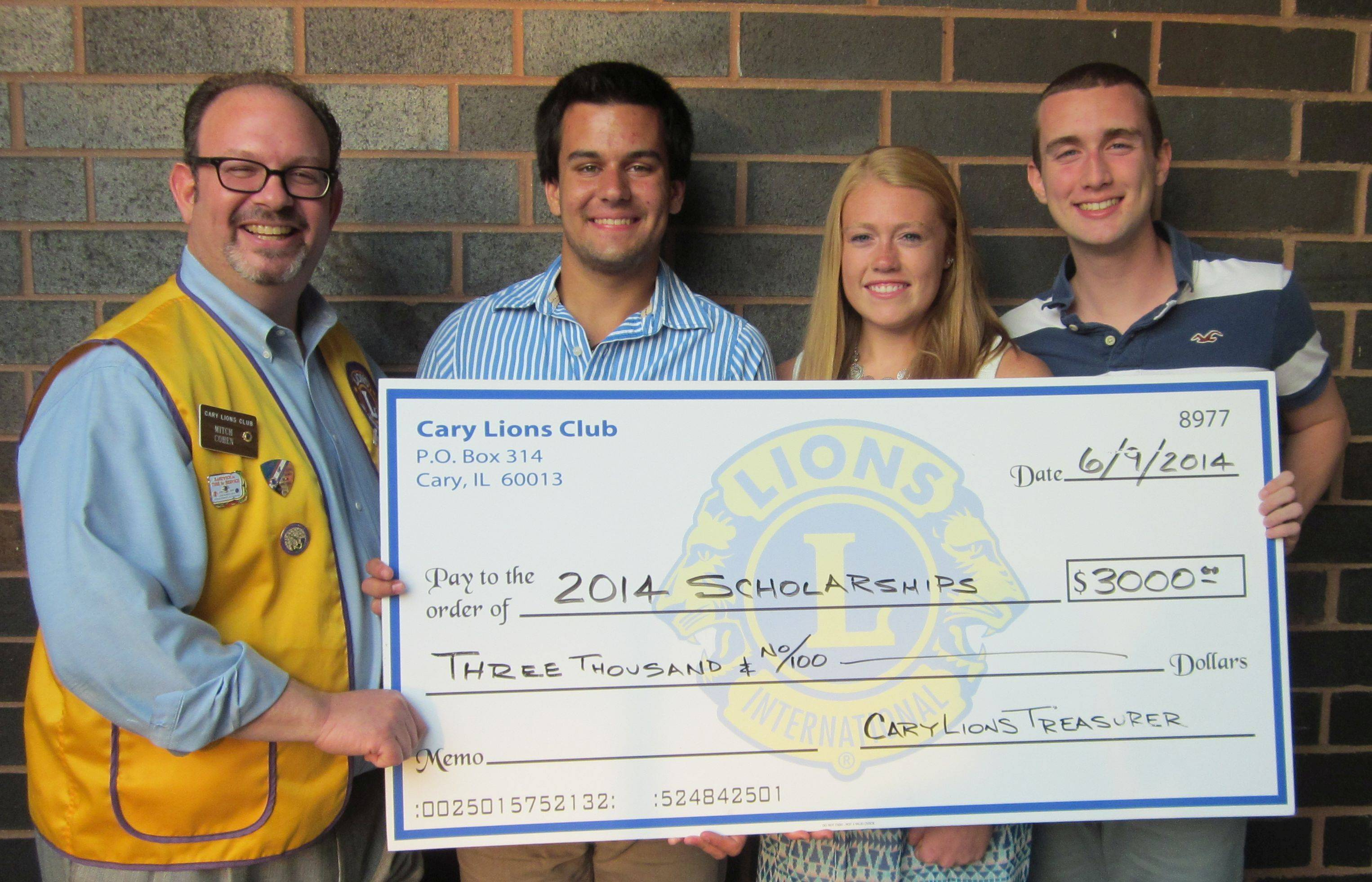 Cary Lion scholarship chairman Mitch Cohen congratulates winners Samuel Rita, Sarah Kendeigh and Griffin Dempsey.