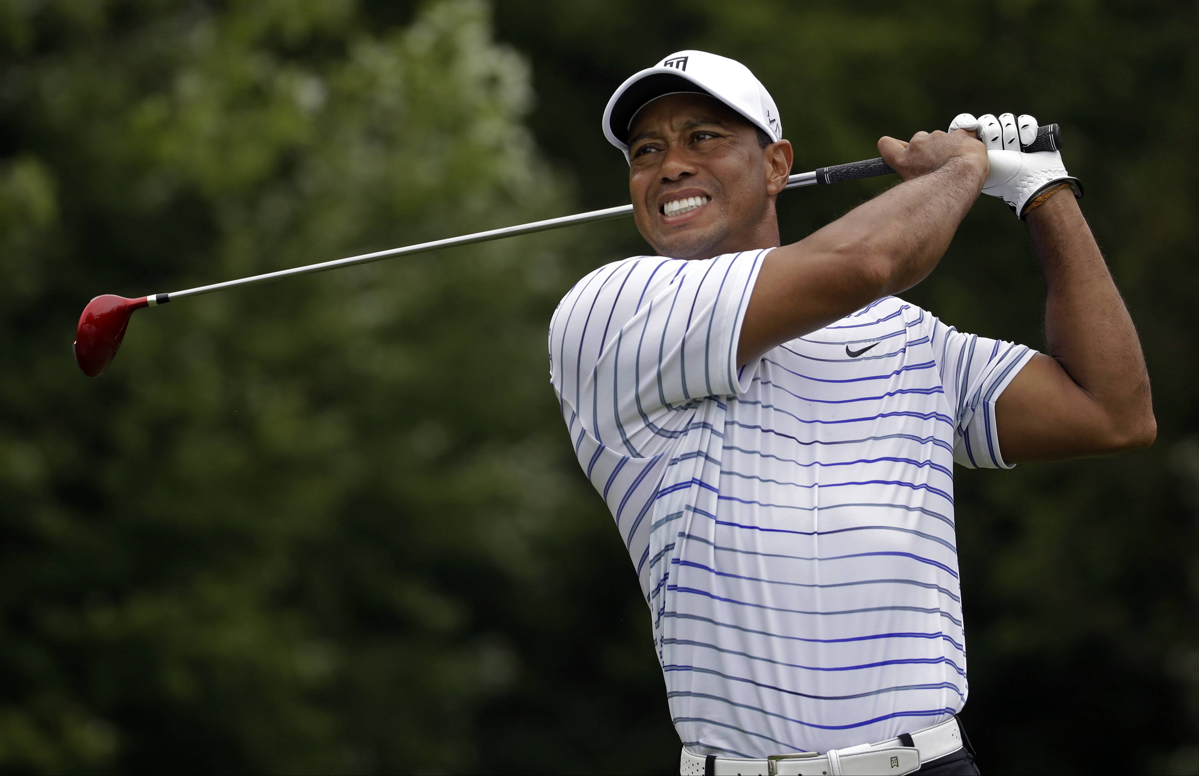 Tiger Woods winces after tee shot on the sixth hole during the second round of the PGA Championship golf tournament at Valhalla Golf Club on Friday, Aug. 8, 2014, in Louisville, Ky.